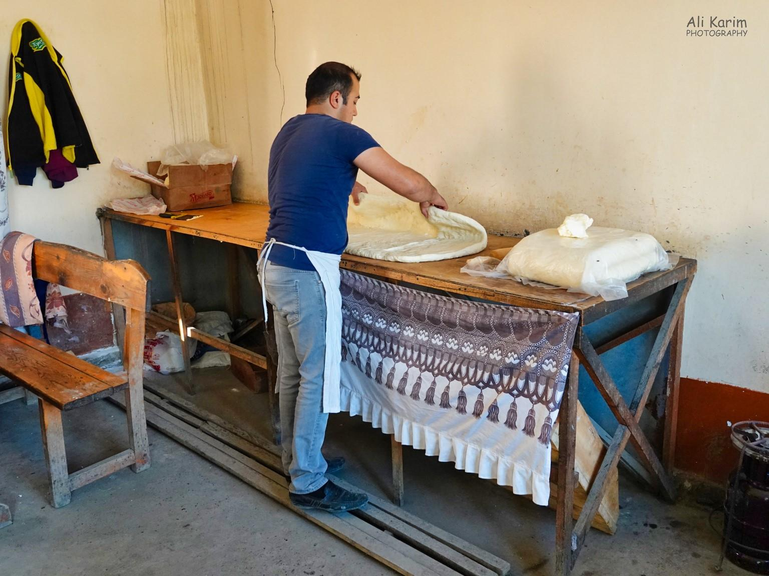 Samarkand, Uzbekistan Rolling out the dough for more samsa's for the evening at the roadside bakery