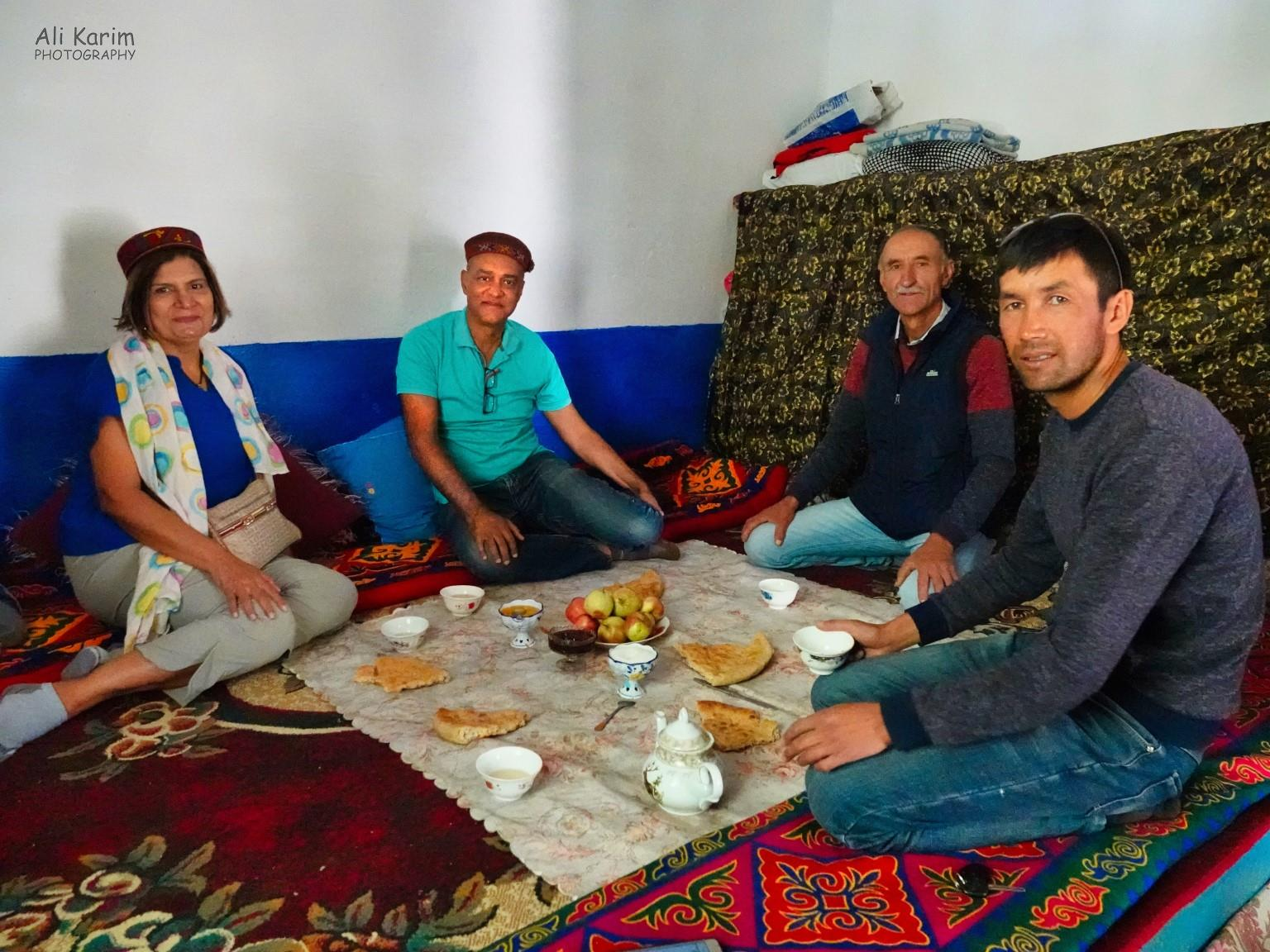 Onto Khorog, Tajikistan, Tea, bread, jam and fresh fruit from the backyard, with Kurbanali and Ahmedali