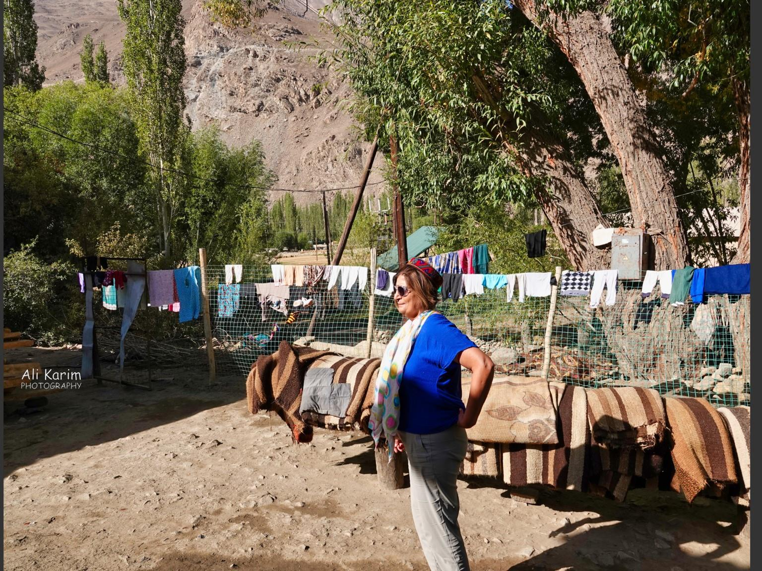 Onto Khorog, Tajikistan, Courtyard; clothes and carpets all cleaned and drying. Note the landscape in the back
