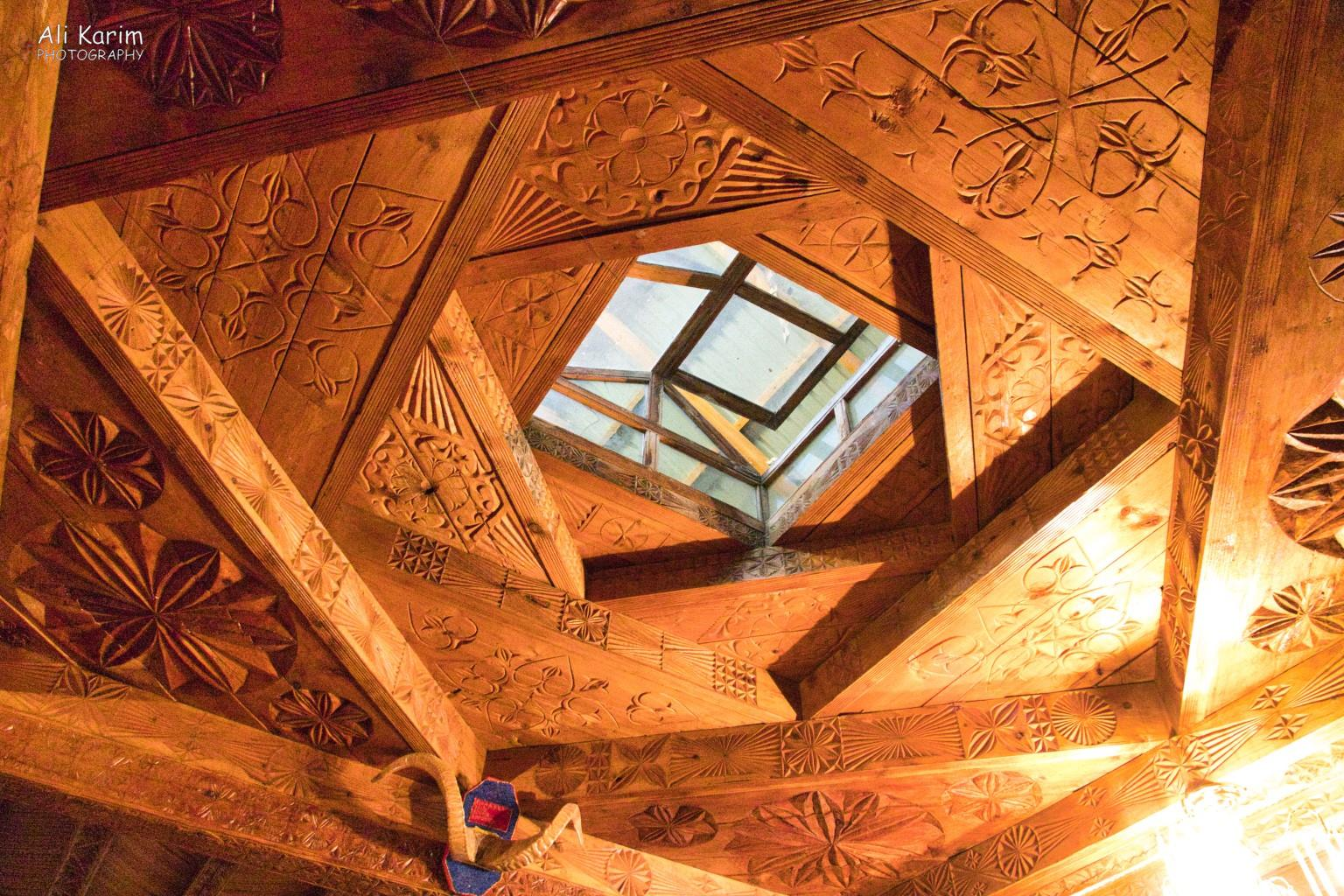 Langar, Bulunkul Tajikistan, Typical celling structure of Pamiri houses, this design is supposed to withstand earthquakes better. Note all the designs carved in this ceiling of the Prayer Hall
