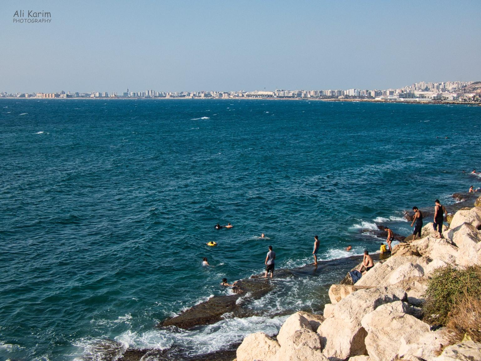 Beirut to Tripoli City of Tripoli, and bathers enjoying the sea from the flat rocks in the water