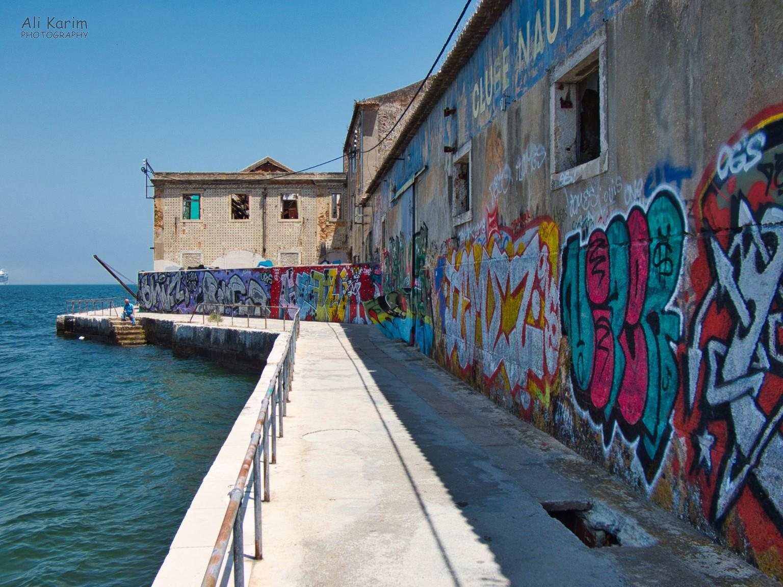 Old, disused and decaying wharf with colorful graffiti