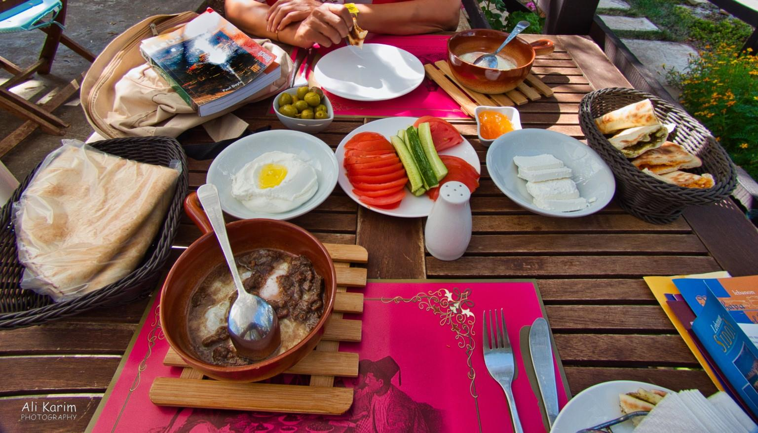 Druze and the Chouf Mountains Typical Druze breakfast of eggs fried with goat meat in a porcelain pan, with Manoushe, bread, olives, cheese, btter, marmalade, humus, tomato's and cucumber.