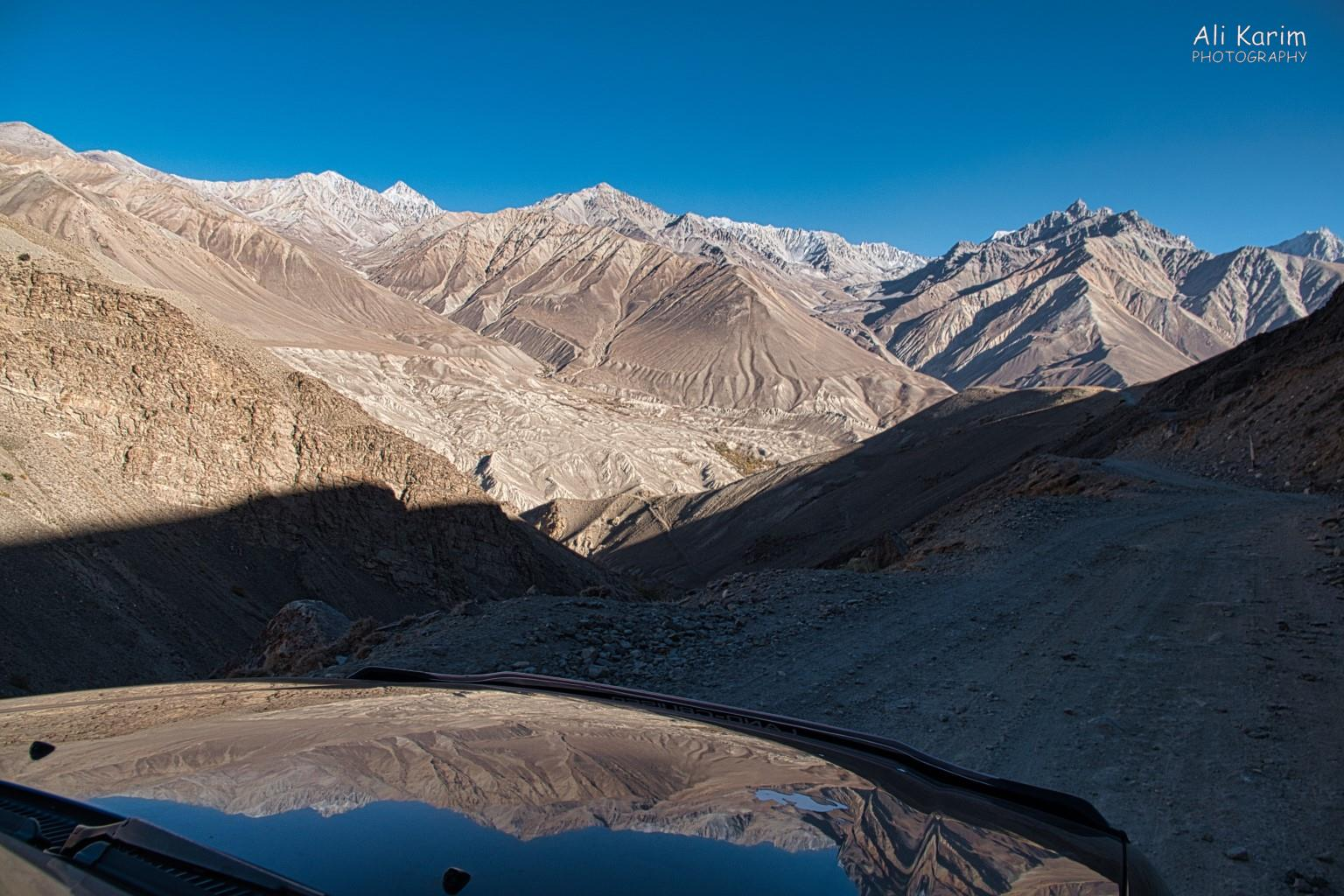 Langar, Tajikistan, Spectacular Pamir mountains on Afghan side, reflected on our hood