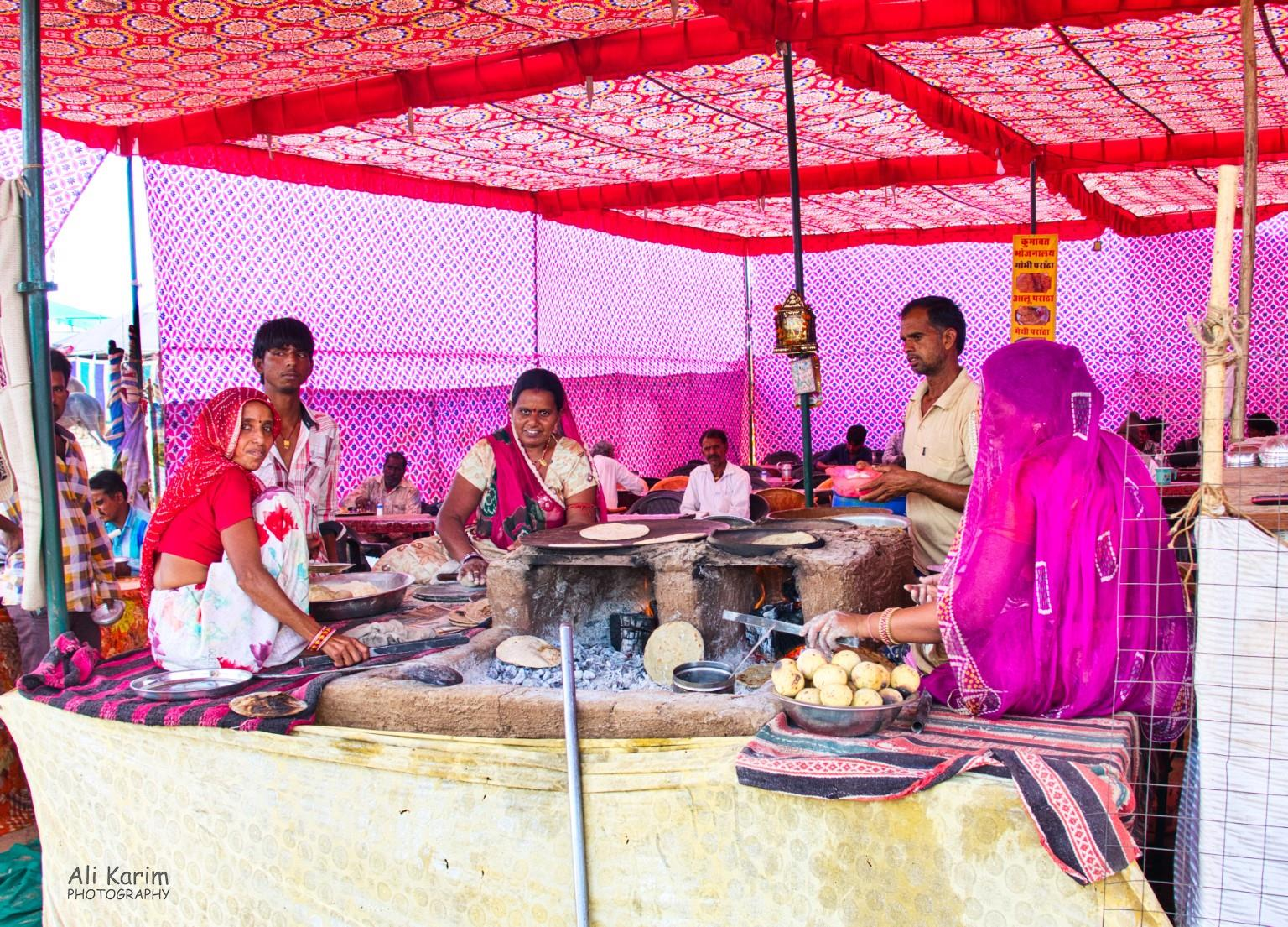 Pushkar, Rajasthan Food stall, with ladies making the typical Baati wheat balls, and baajra roti