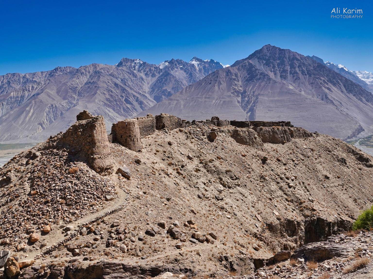 Langar, Bulunkul Tajikistan, Yamchun Fortress, built with stones, dating between 300-100BC. Locally referred to as Zamr-I Atisht Parasht, the fortress of the fire worshippers, meaning Zoroastrianism was strong in the Pamirs back then. A fire temple might have housed inside the fortress.