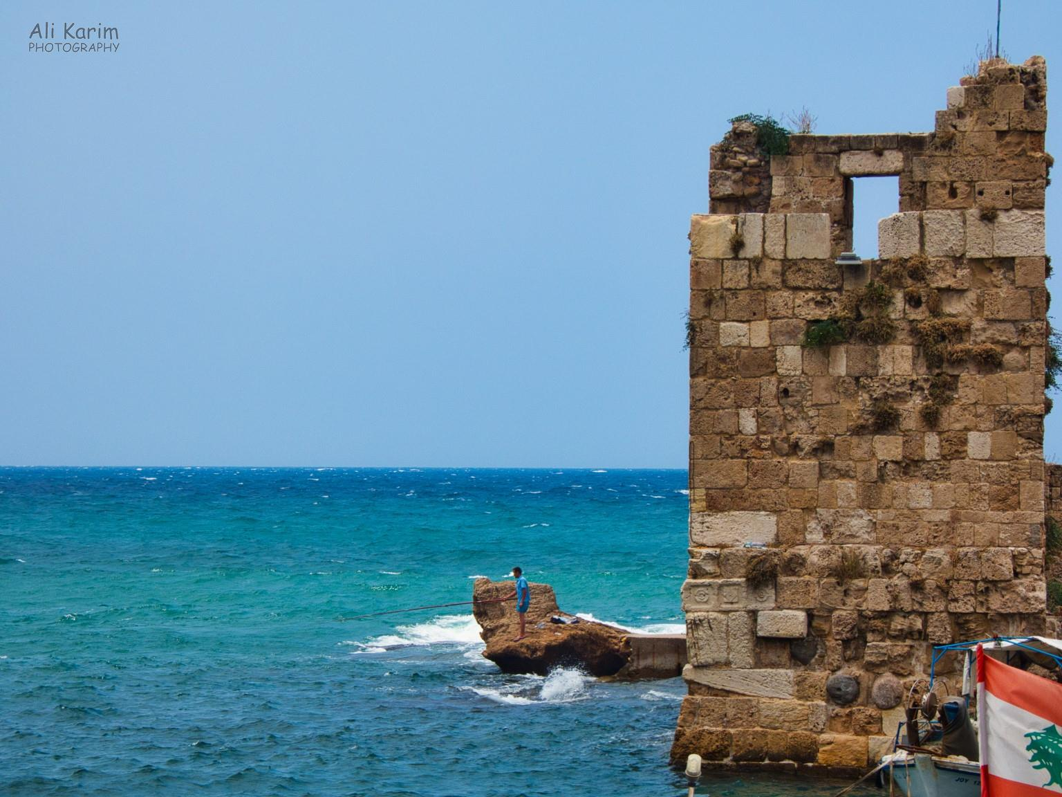 Beirut to Tripoli Fortification guarding the harbor entrance from the olden times, lone fisherman