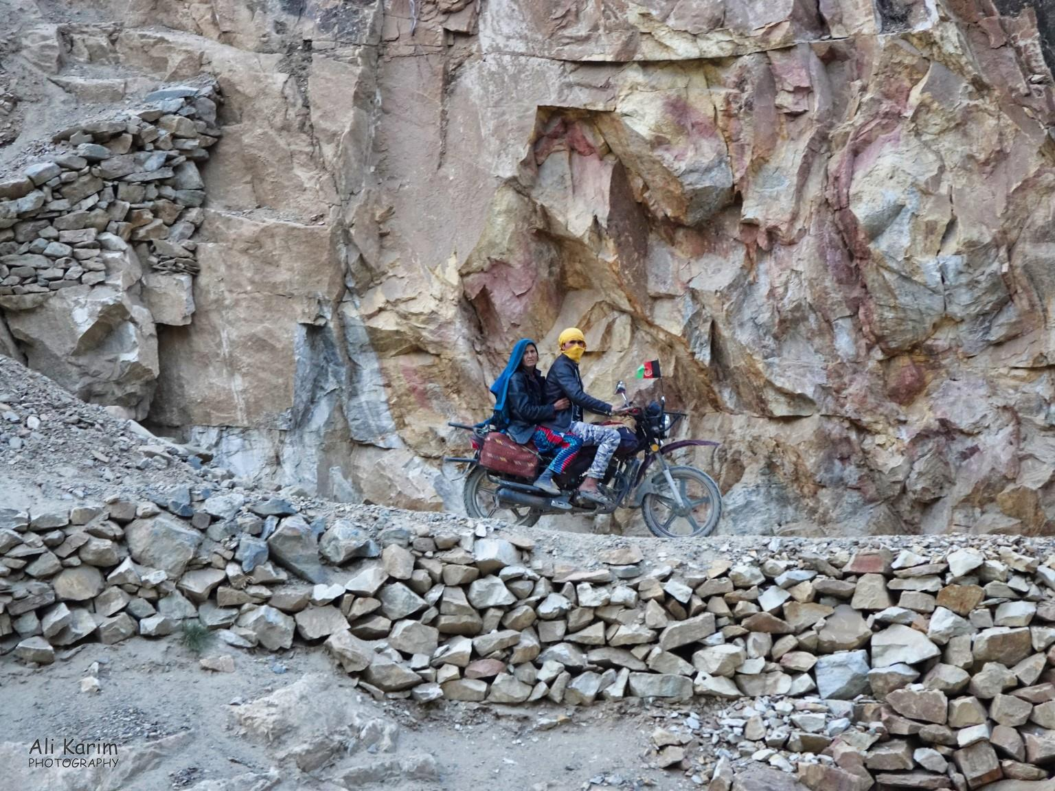 Dushanbe, Tajikistan Riders on the Afghan side, checking us out. The drop to the Panj river was very steep here.