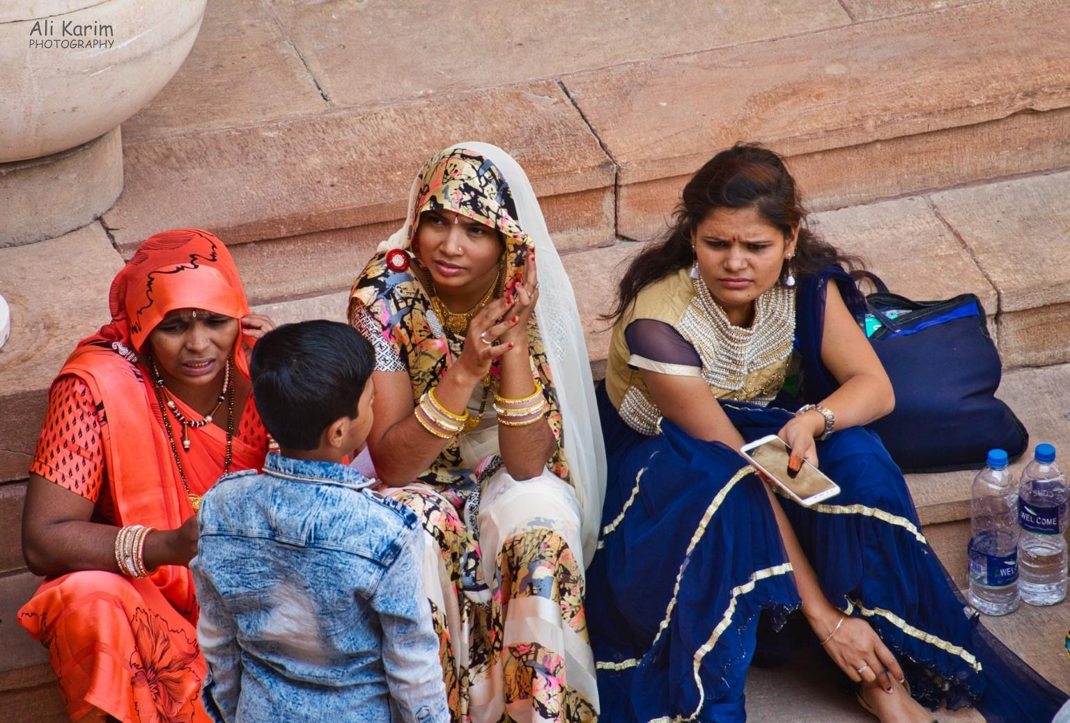 Jodhpur, Rajasthan Local tourists taking a breather from checking out the Fort; note the clothing and jewelry
