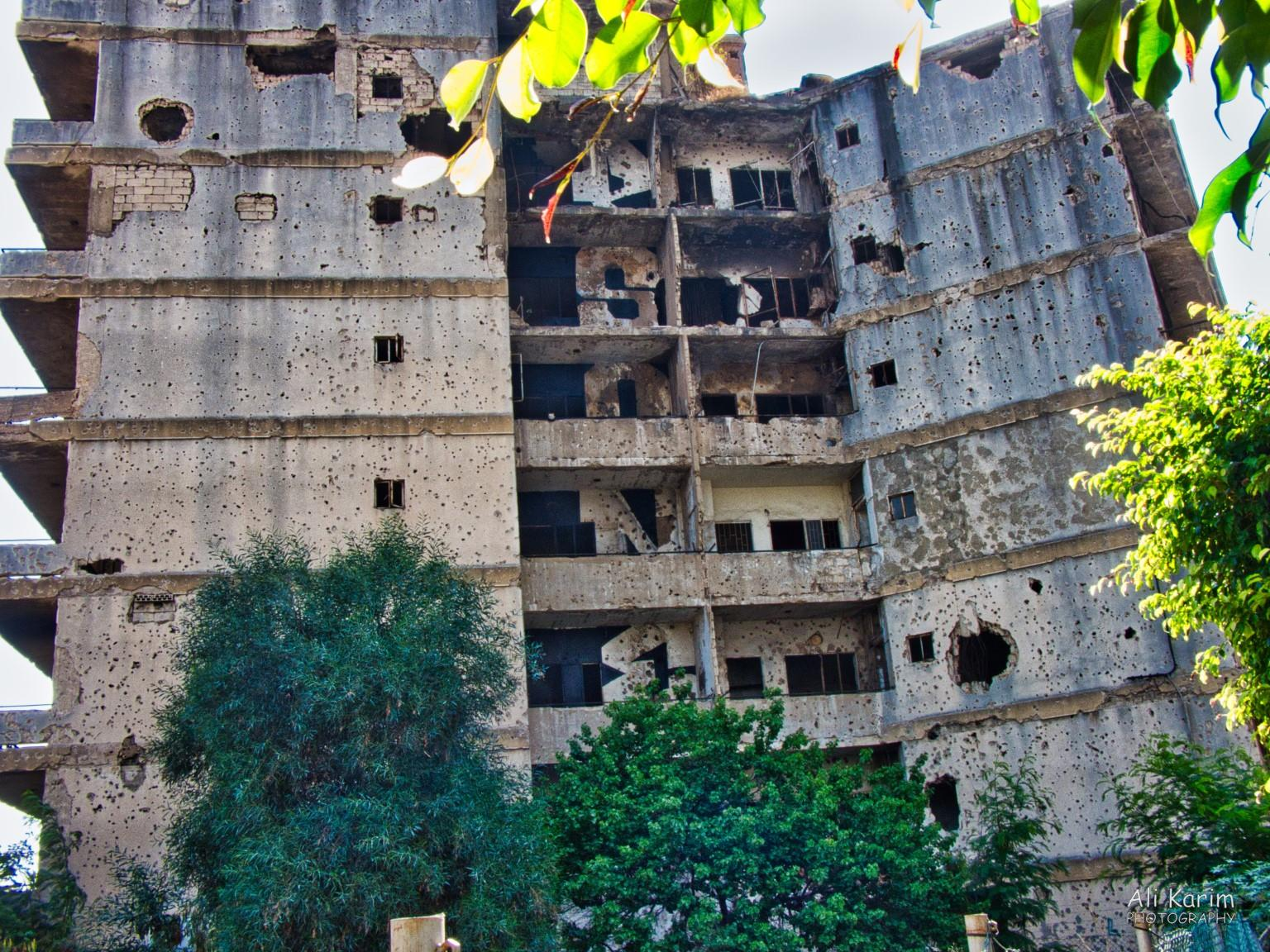 Building in much worse shape with bullet and mortar shell holes