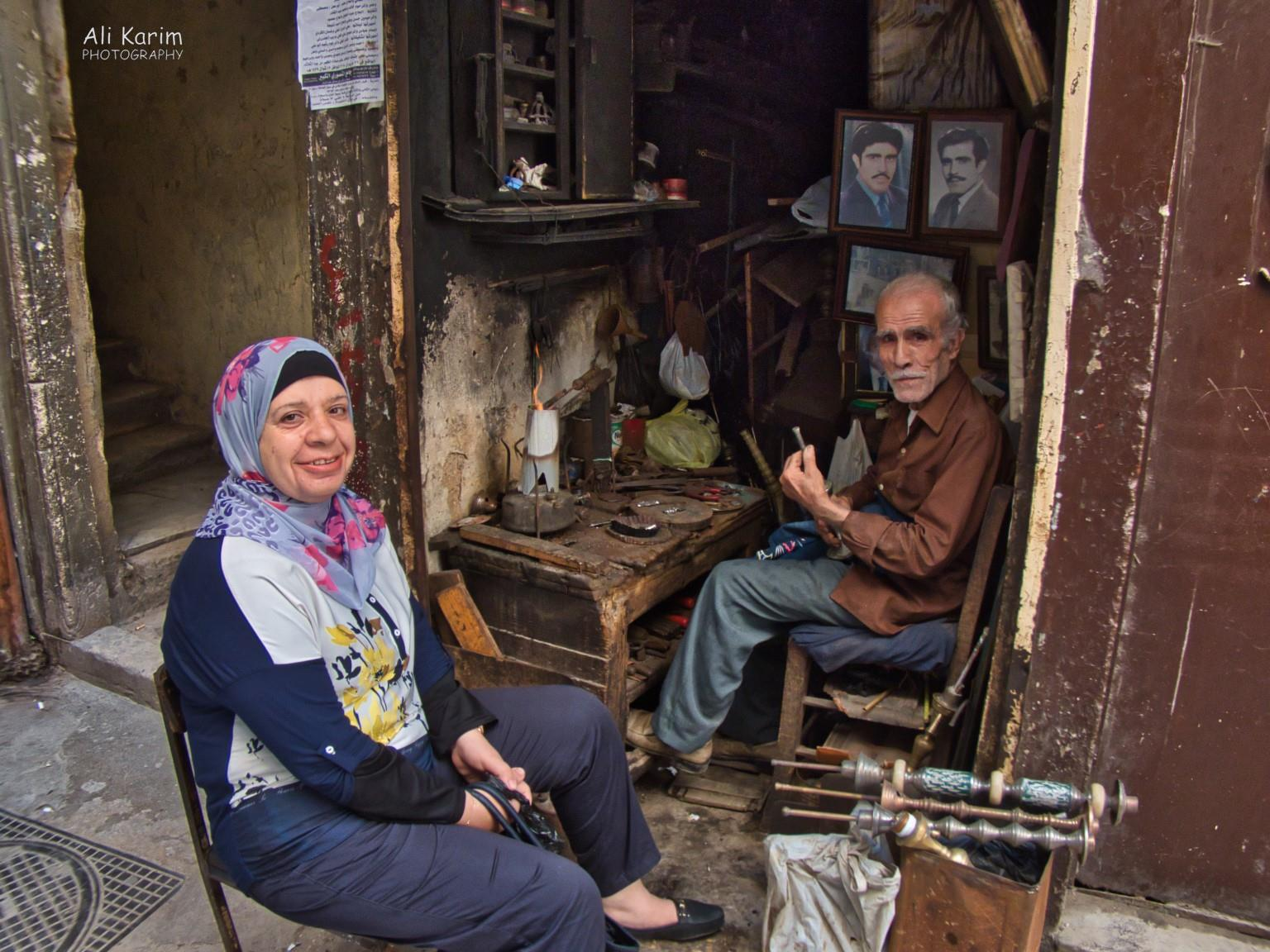 Tripoli Lebanon Hookah (Sheesha) repair shop and client; note the pictures of the owner, when younger