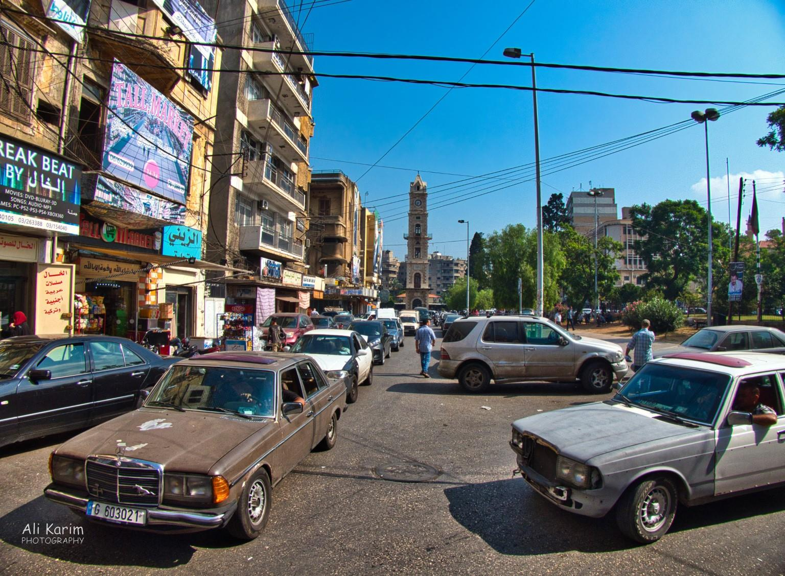 Tripoli Lebanon Sultan Abdul Hamid clock tower in the back in a large green park in the center of old Tripoli; is a landmark here. People like their Mercedes Benz's here; lot of older MB's here