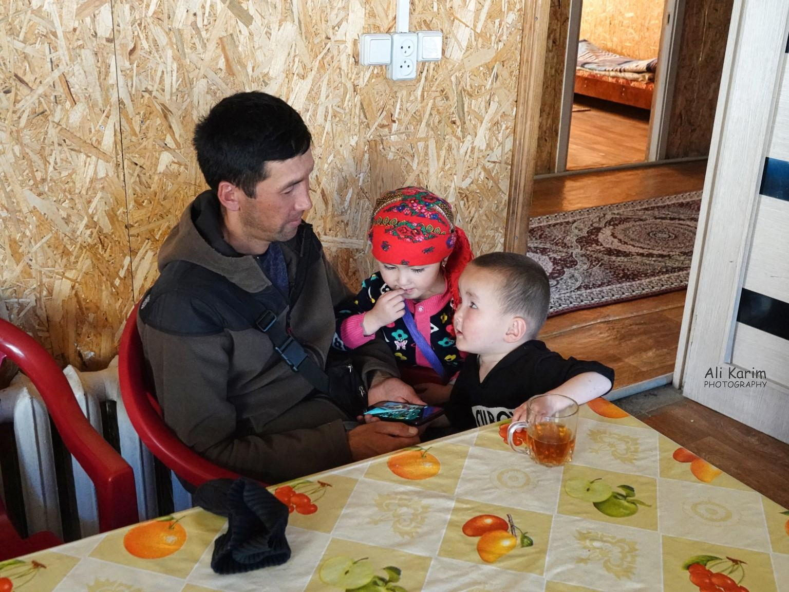 More Murghab & Alichur, Tajikistan, Ahmadali entertaining the owner's kids with movies on his phone
