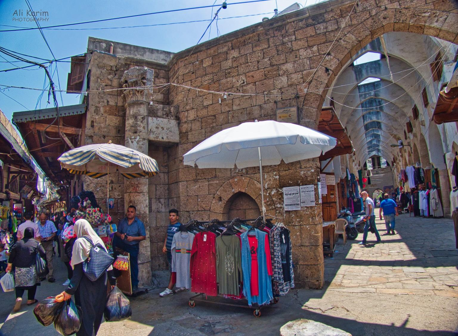 Tripoli Lebanon Clothes Hamam; note the shopkeeper center-left, leaning on the old Roman Column