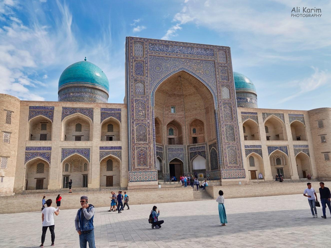 Bukhara, Oct 2019, The Mir Arab Madrassah, with its 2 blue tiled domes, was across the square from the mosque