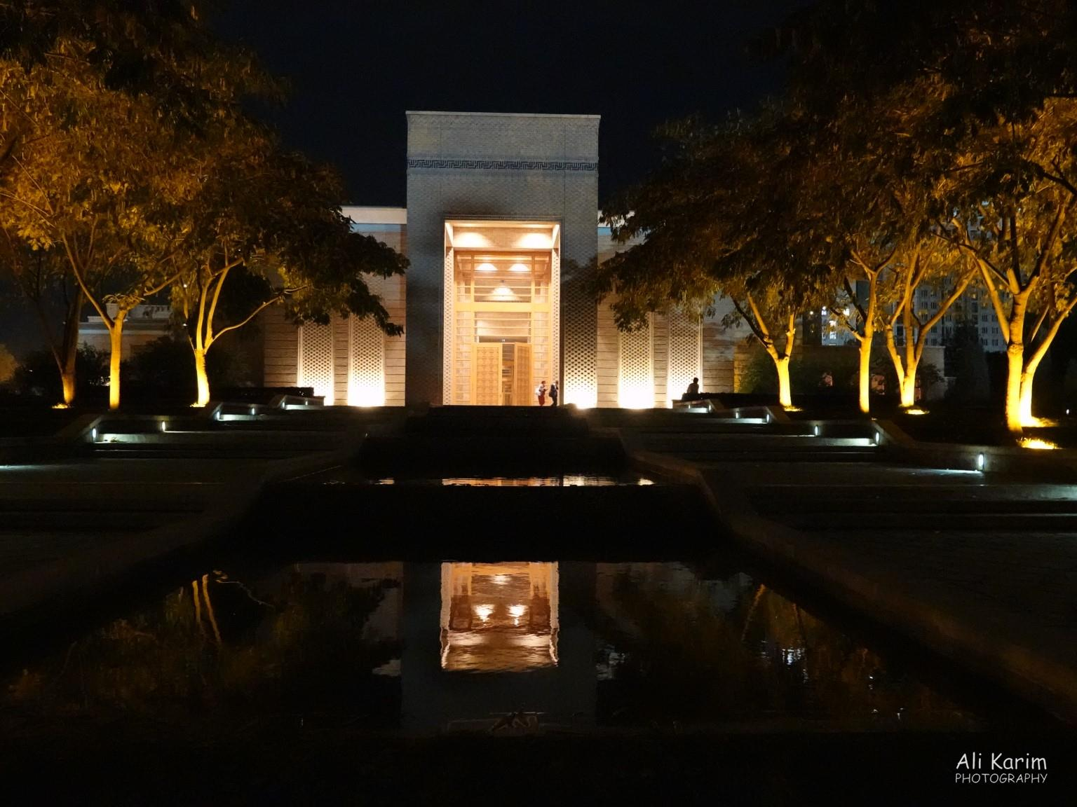 Dushanbe, Tajikistan Entrance of the imposing Center at night, with reflective water gardens