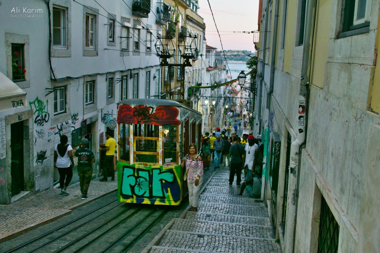 Lisbon Portugal: The Ascensor de Bica funicular, with lively action along its tracks in the evenings