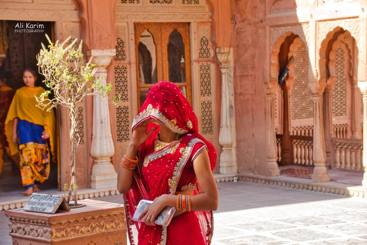 Bikaner, Rajasthan Palace grounds; many Rajasthani women covered their faces with their sari's to keep away evil gazes