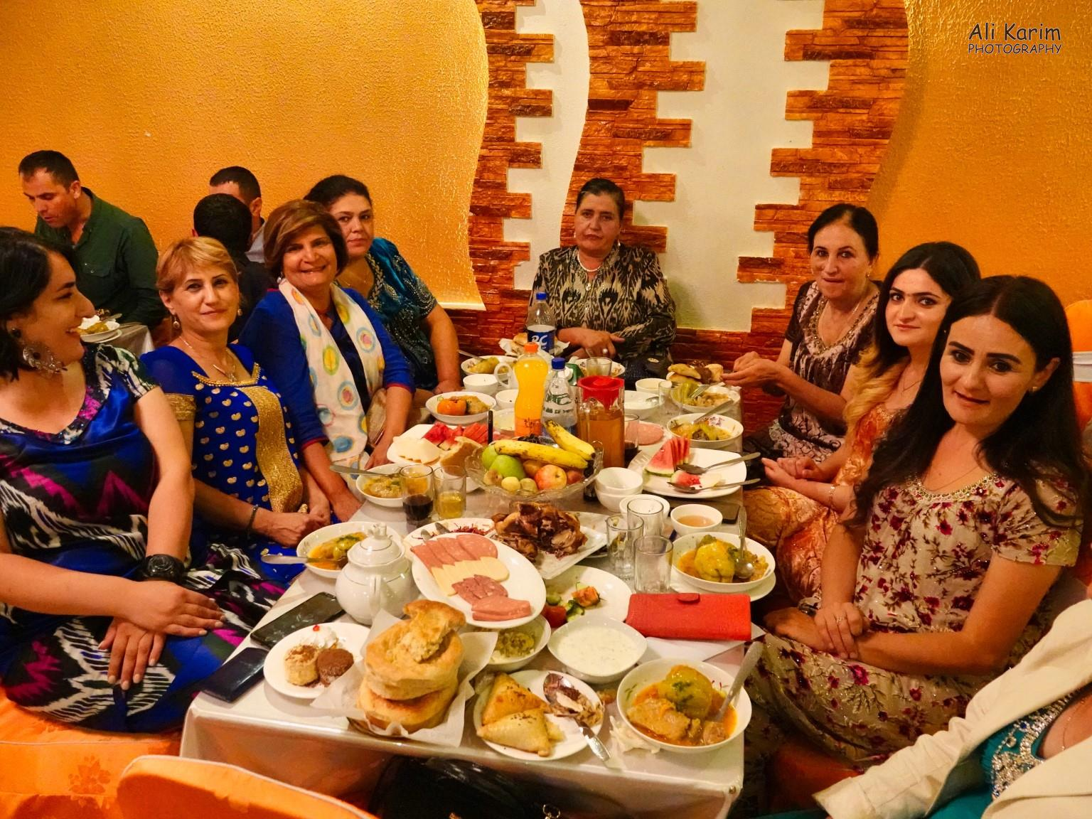 Onto Khorog, Tajikistan, Dilshad with Gulguncha on her right, at their table. Notice how the table is overflowing with food