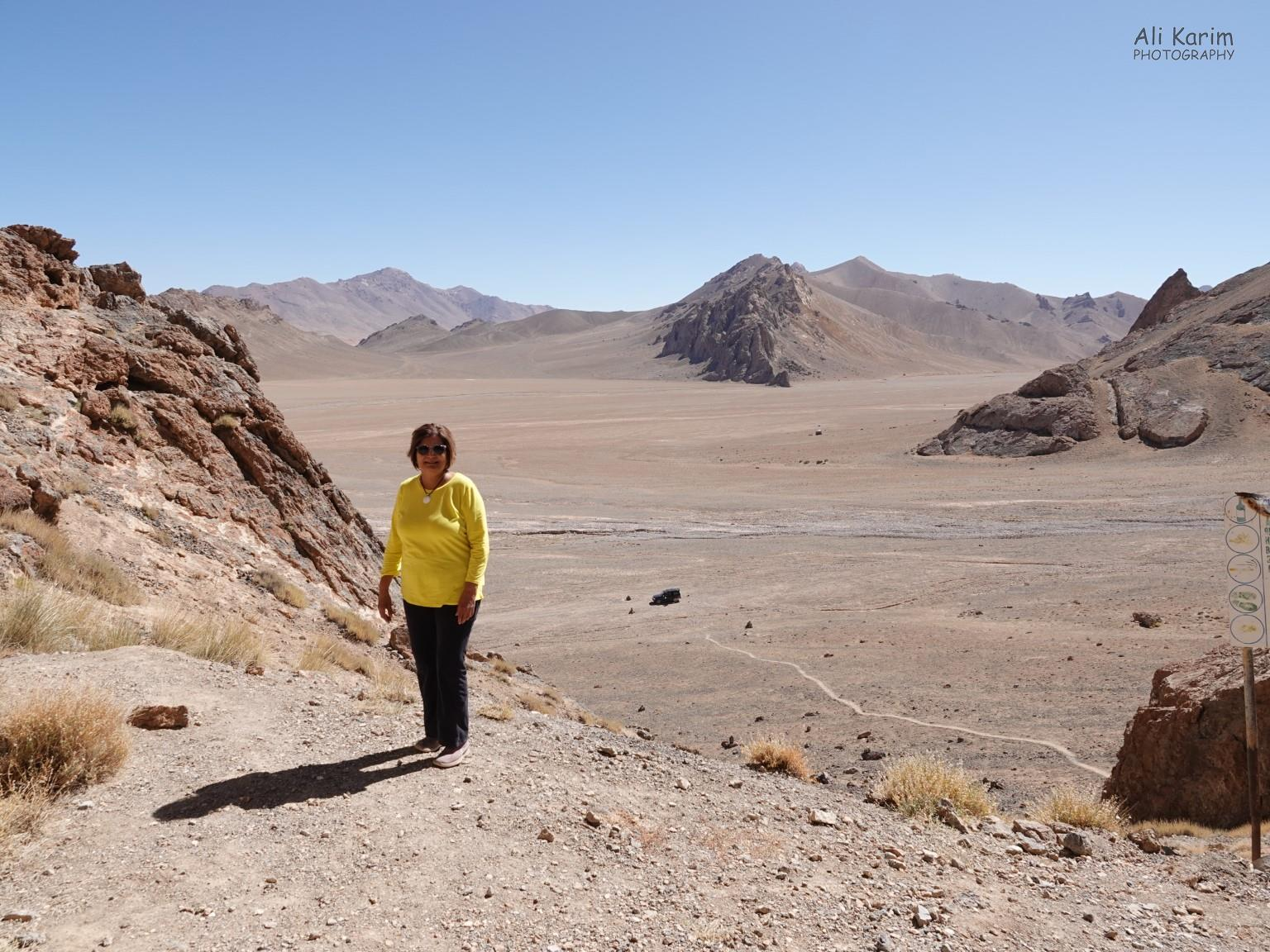 More Murghab & Alichur, Tajikistan, View of the Kurteskei valley from the Shakhty cave entrance. The vastness, scale, & desolation of this dramatic high mountain desert valley was awe-inspiring. Note our car at the bottom of the hill for size perspective