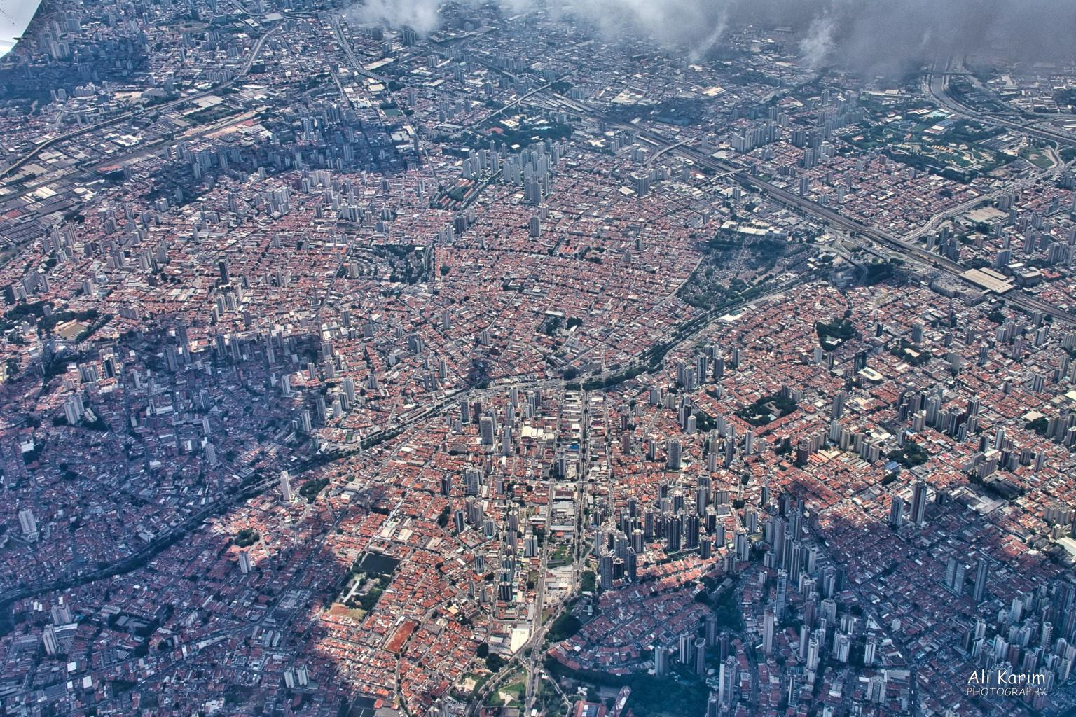 Florianópolis, Brazil São Paulo as seen on the flight from São Paulo to Floripa. The shaded area due to clouds makes for an interesting picture. This type of dense urban space went on for miles.