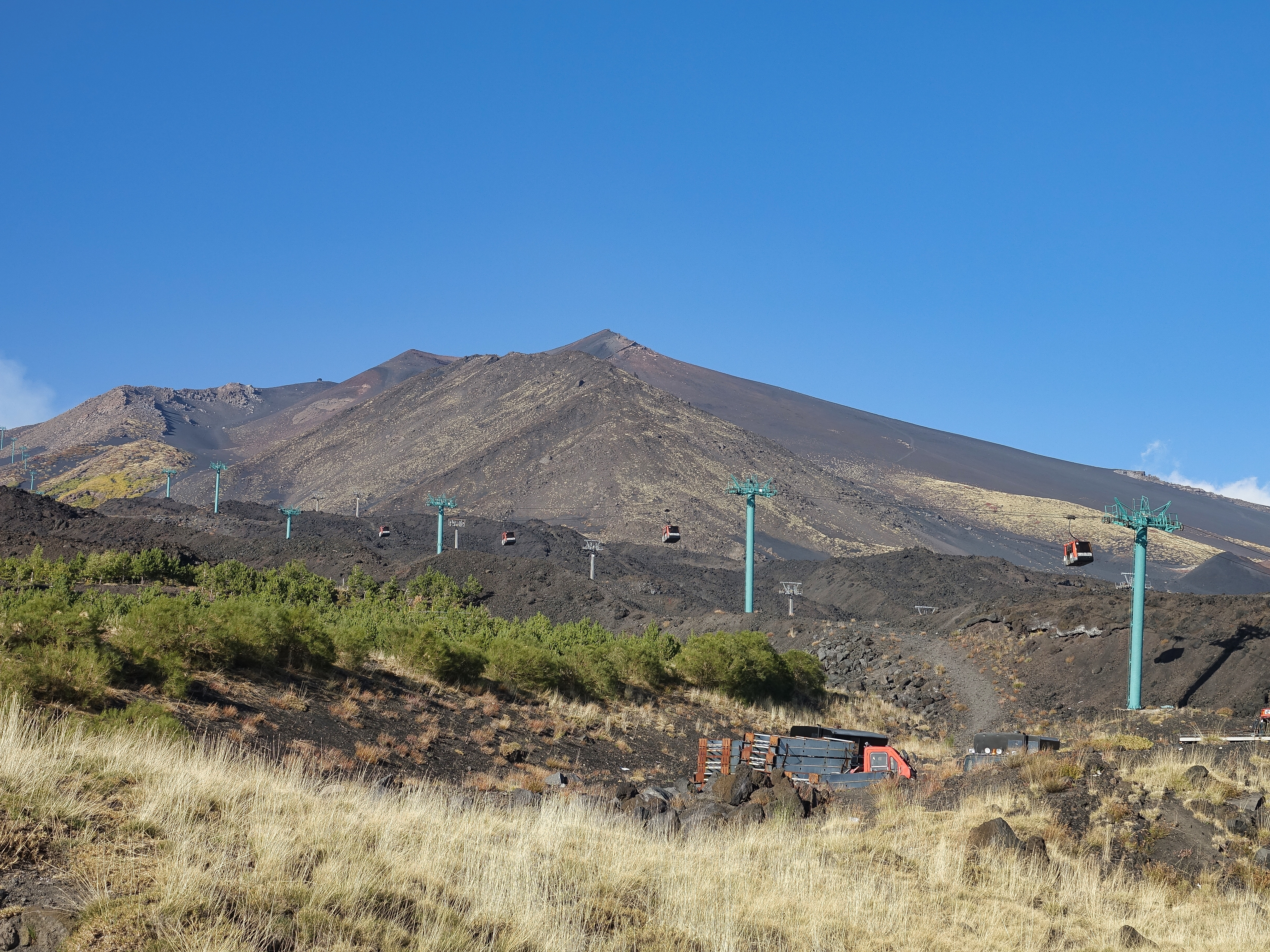 Cable cars going higher up Mt Etna