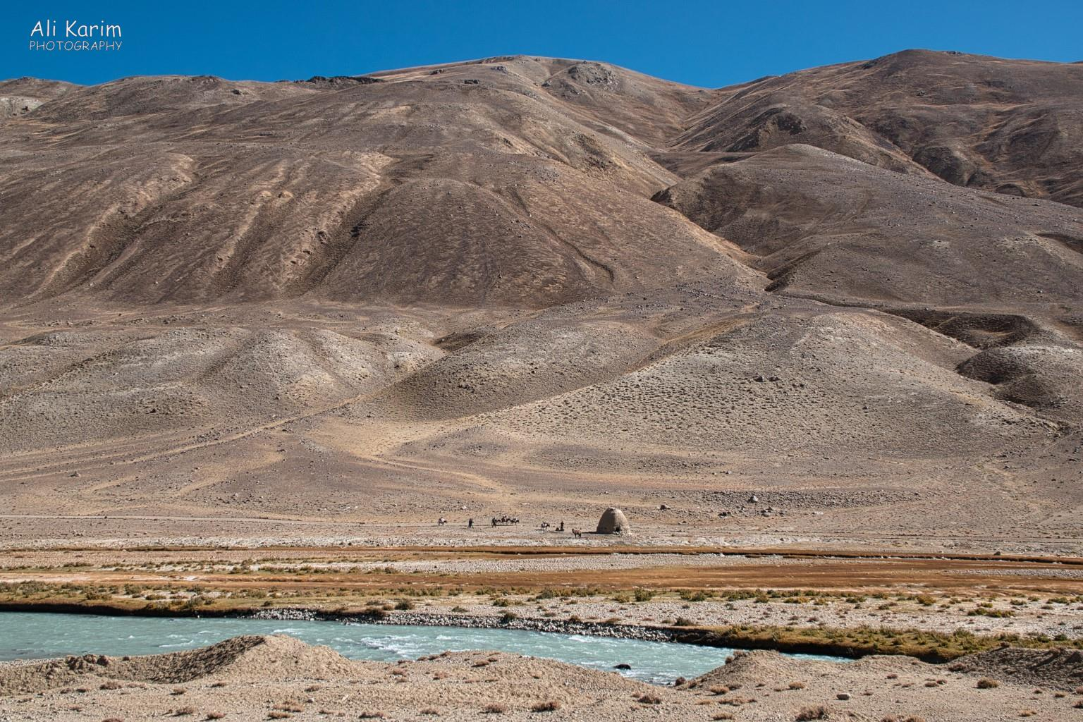 Langar, Tajikistan, Caravan and Caravanserai in the harsh landscape; perspective