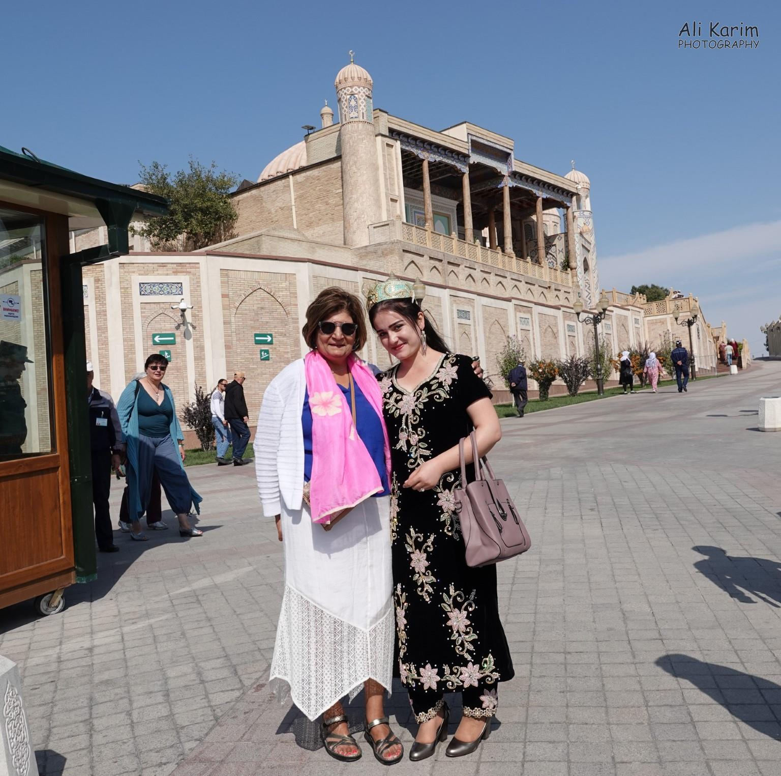 More Samarkand, Friendly locals; the building behind them is the Hazrati Hizr mosque and mausoleum of Islom Karmiov, the first president of Uzbekistan