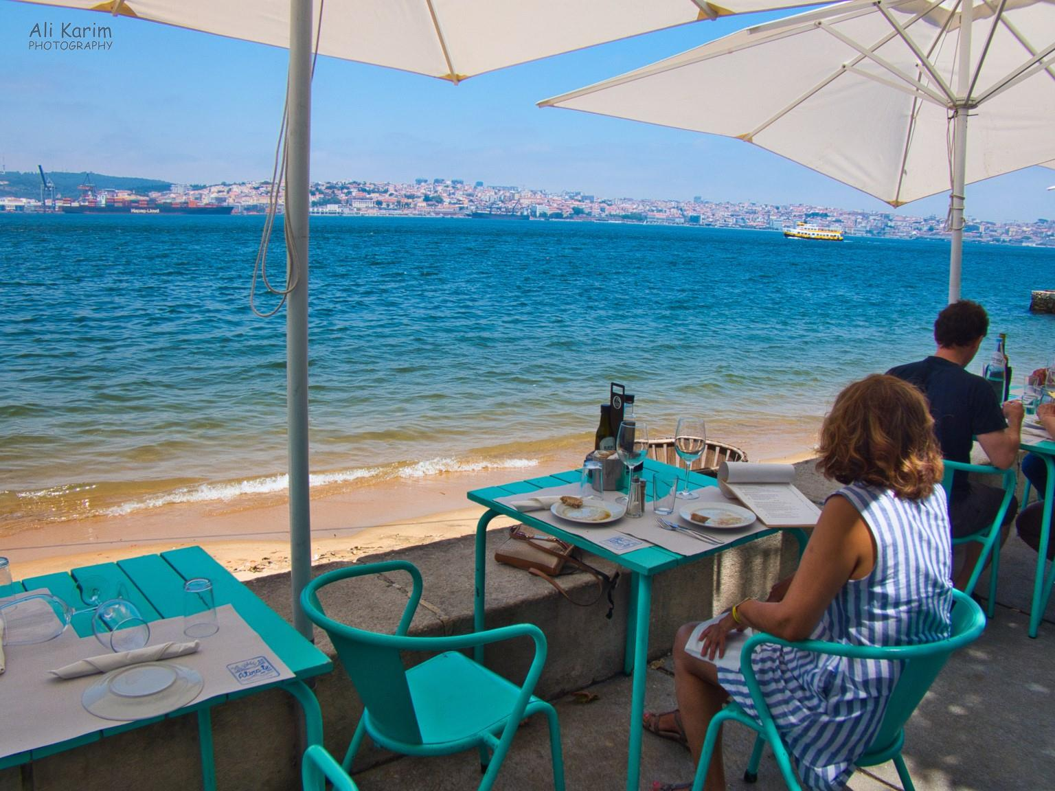 Waterfront dining at the Atira-te ao rio restaurant, views of ships and Lisbon