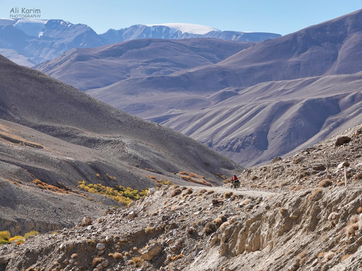 Langar, Tajikistan, Lone biker in remoteness; probably happy its downhill