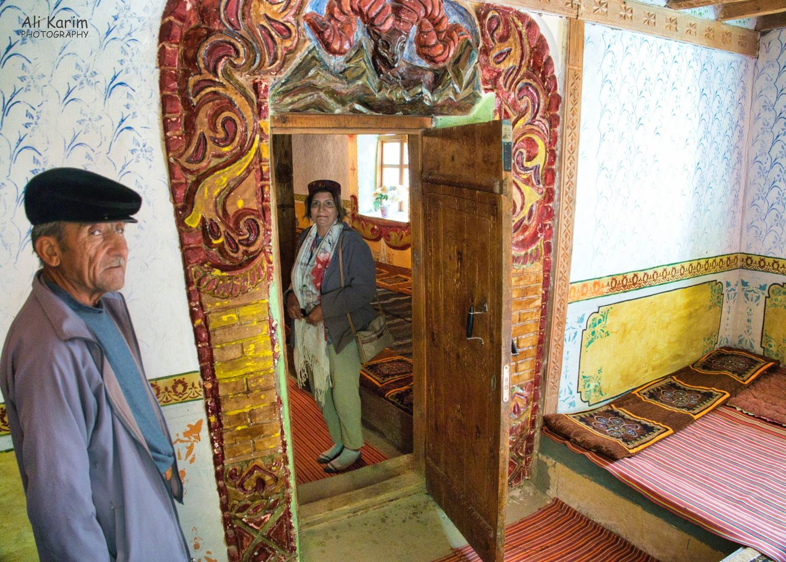 Langar, Bulunkul Tajikistan, Entrance to Prayer Hall from Museum; note the elaborate woodwork and the Marco Polo sheep carving/painting. With the Museum caretaker