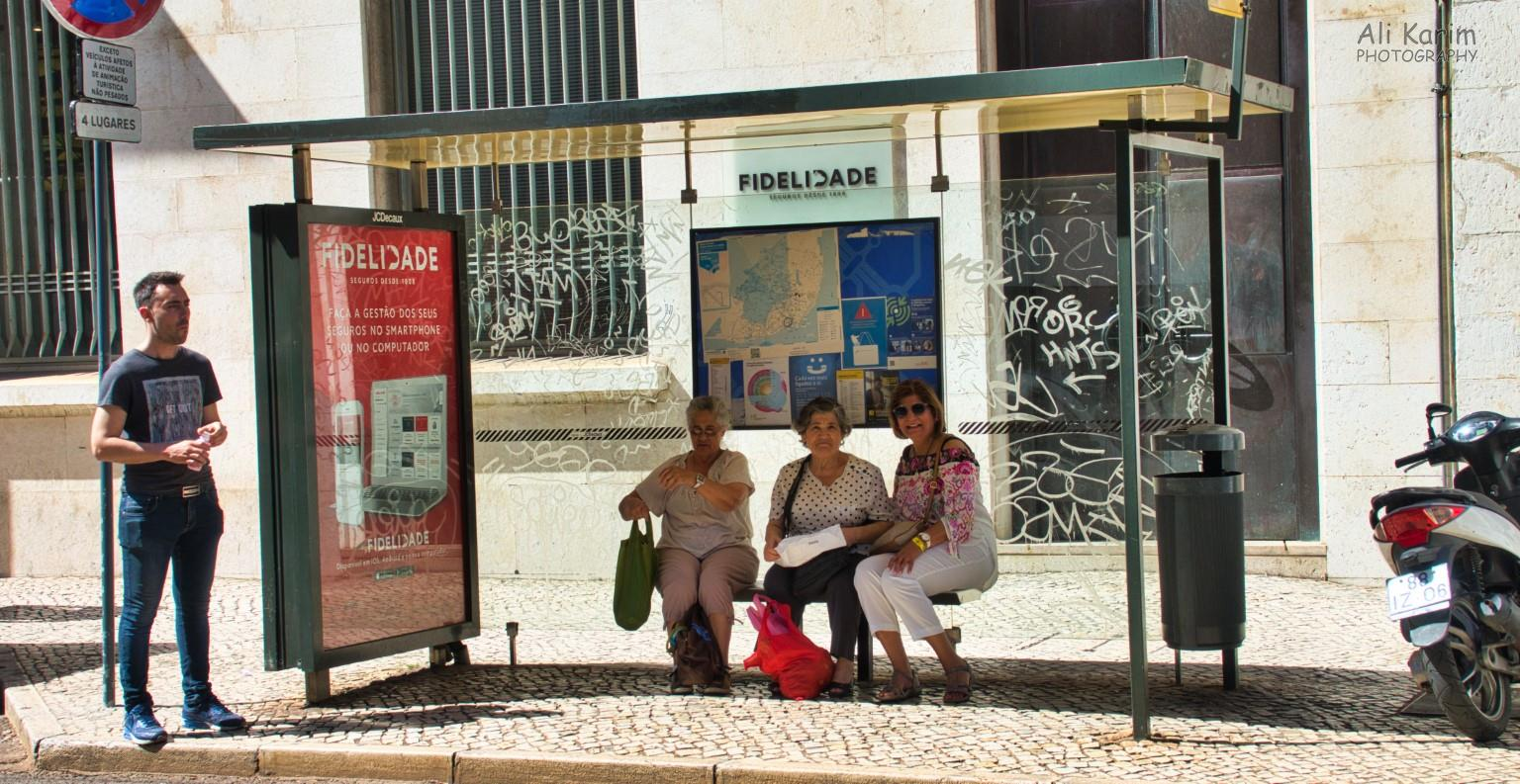 Awaiting the tram in Barrio Alto area with friendly locals
