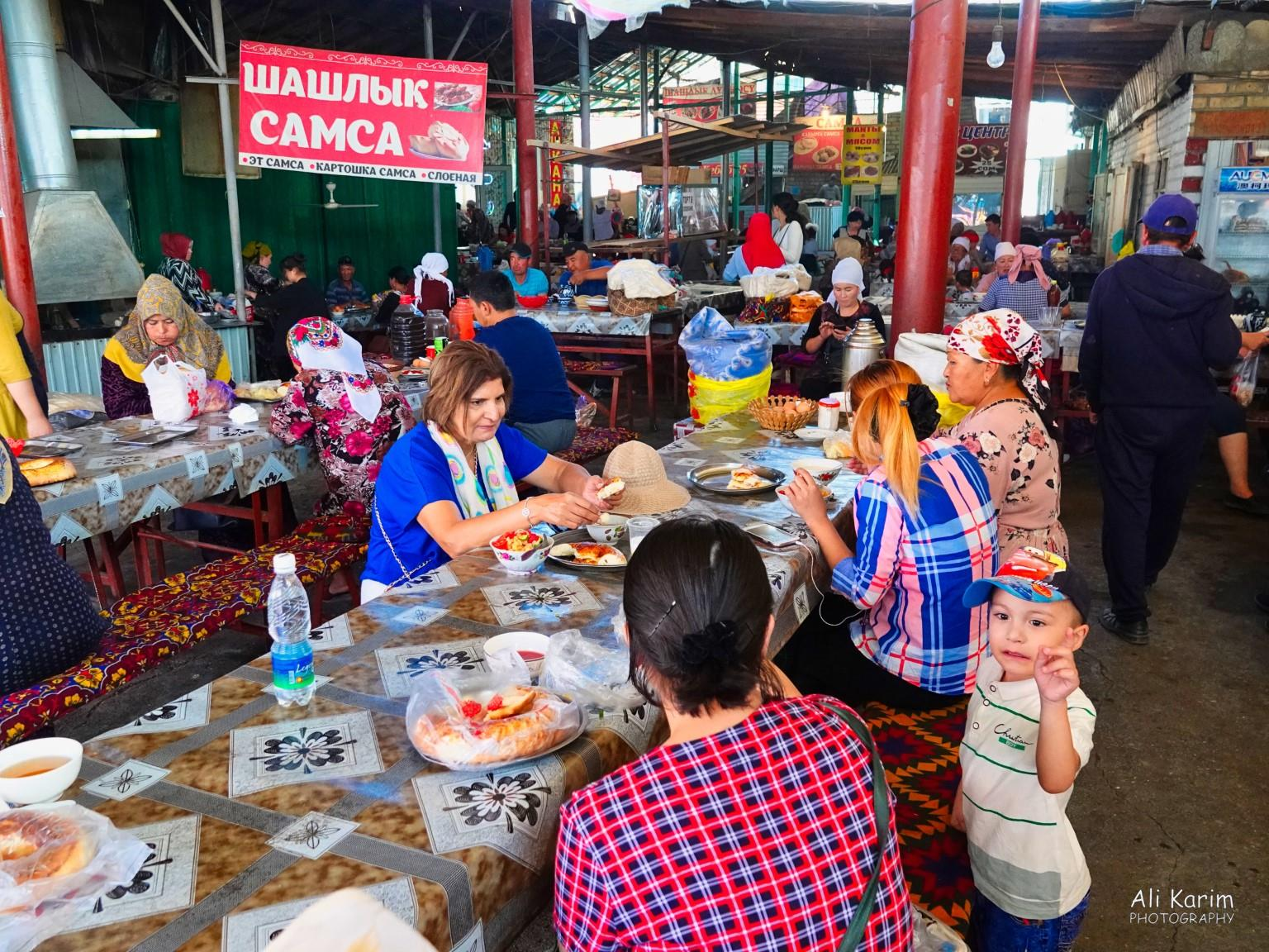 Silk Road 15: Osh, Kyrgyzstan Local food court with many locals eating and multiple small kitchens serving the food
