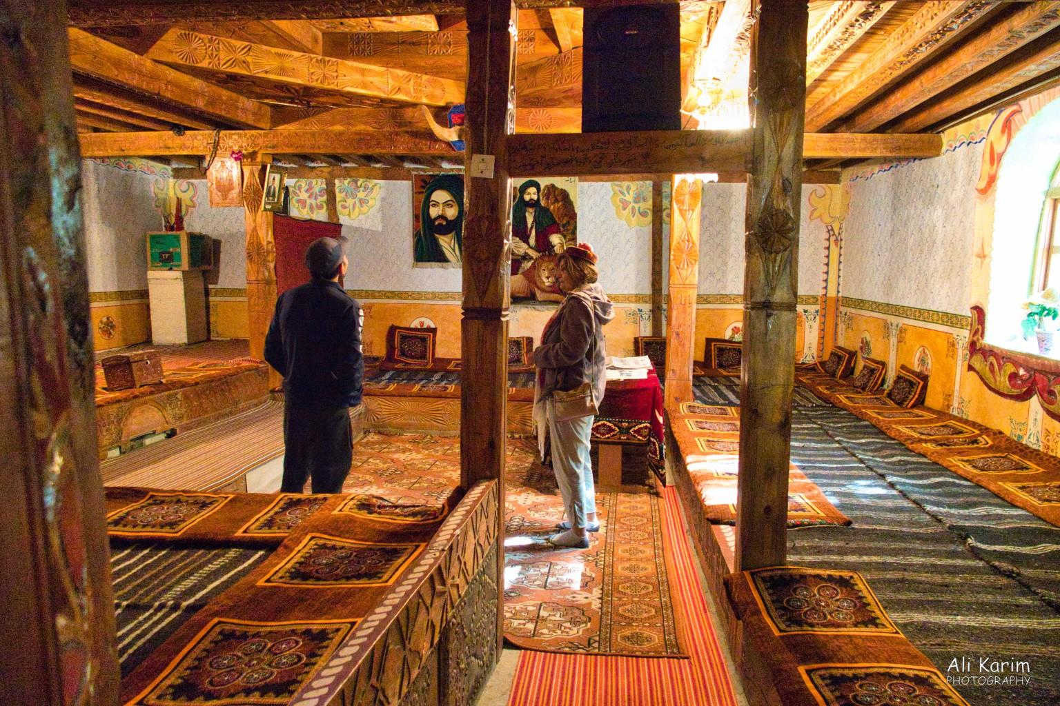 Langar, Bulunkul Tajikistan, Inside the Pamiri prayer house in Langar; similar to the prayer house in Hisor, but with more wood carvings and more elaborate overall