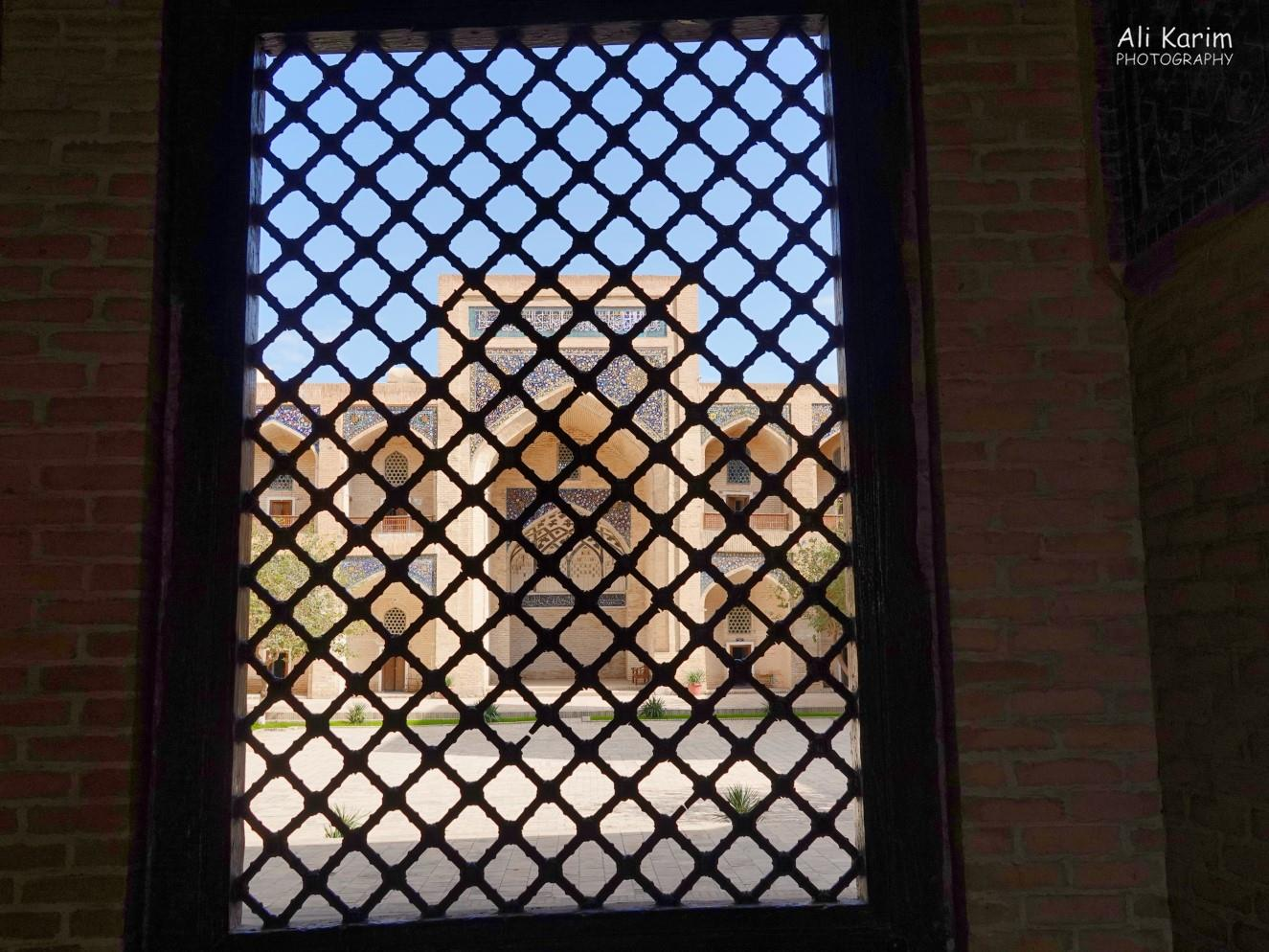 Bukhara, Oct 2019, Latticed view of the mosque from the mausoleum inside the madrassah