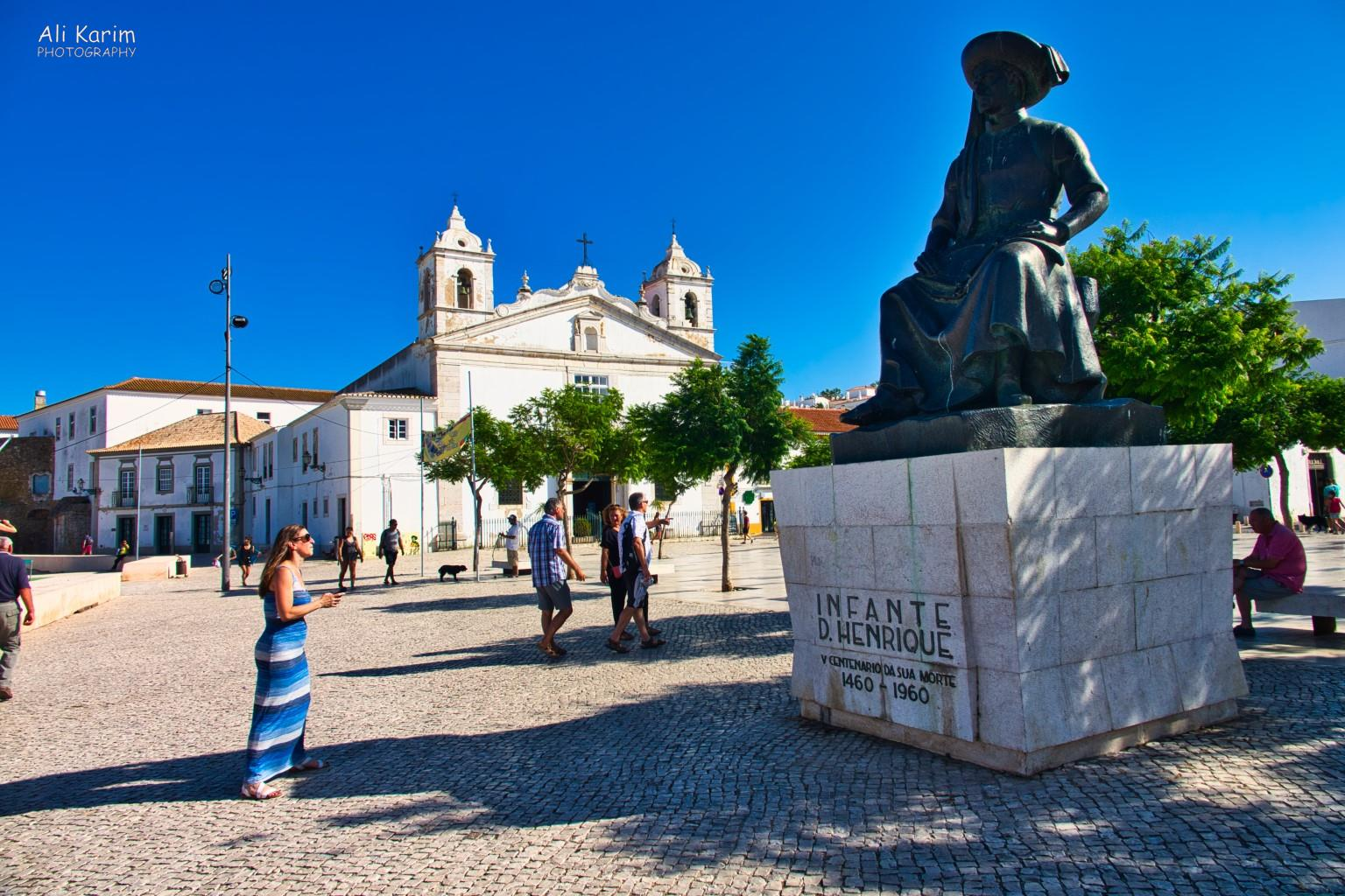Algarve, Portugal Henry the Navigator statue in the main square in downtown Lagos, complete with cathedral