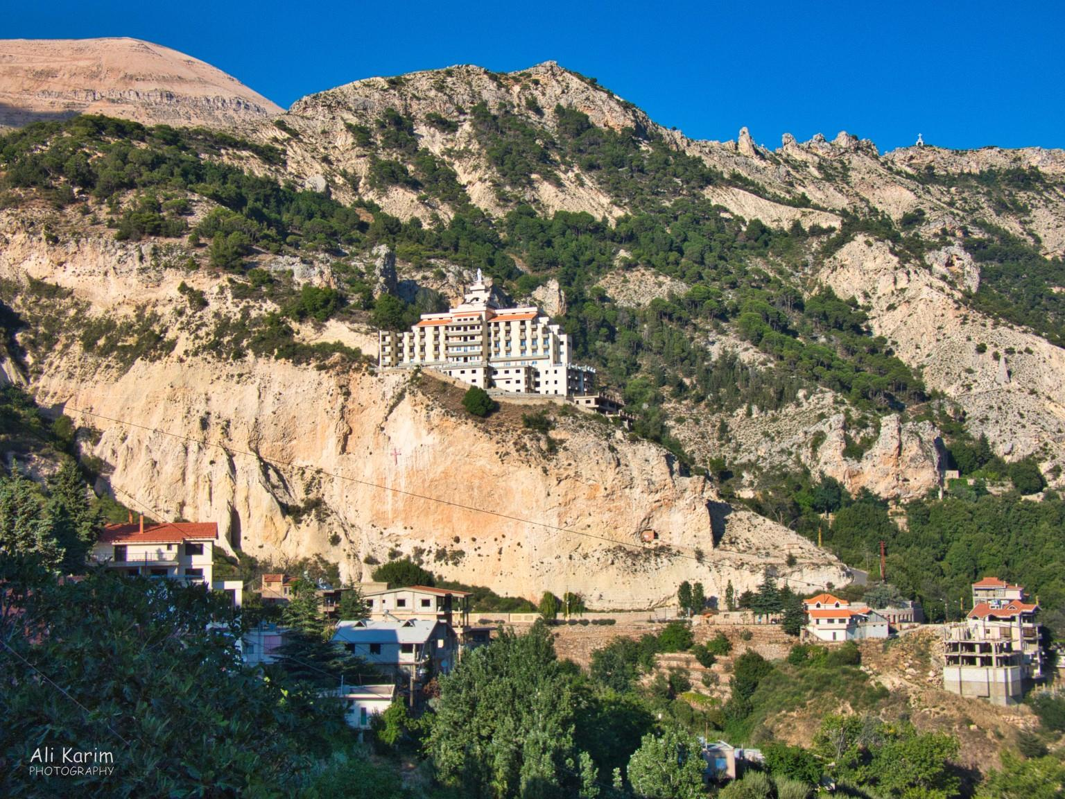 Bsharri and Quadisha Valley Monastery near Bsharri; note the cross on the cliff below the building, and on the mountain above