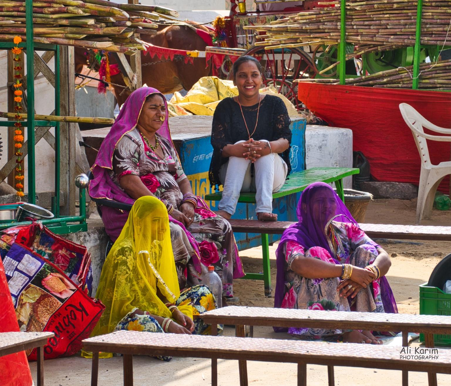 Pushkar, Rajasthan Local women people watching; note how many women cover their faces with their shawls to prevent the evil eye