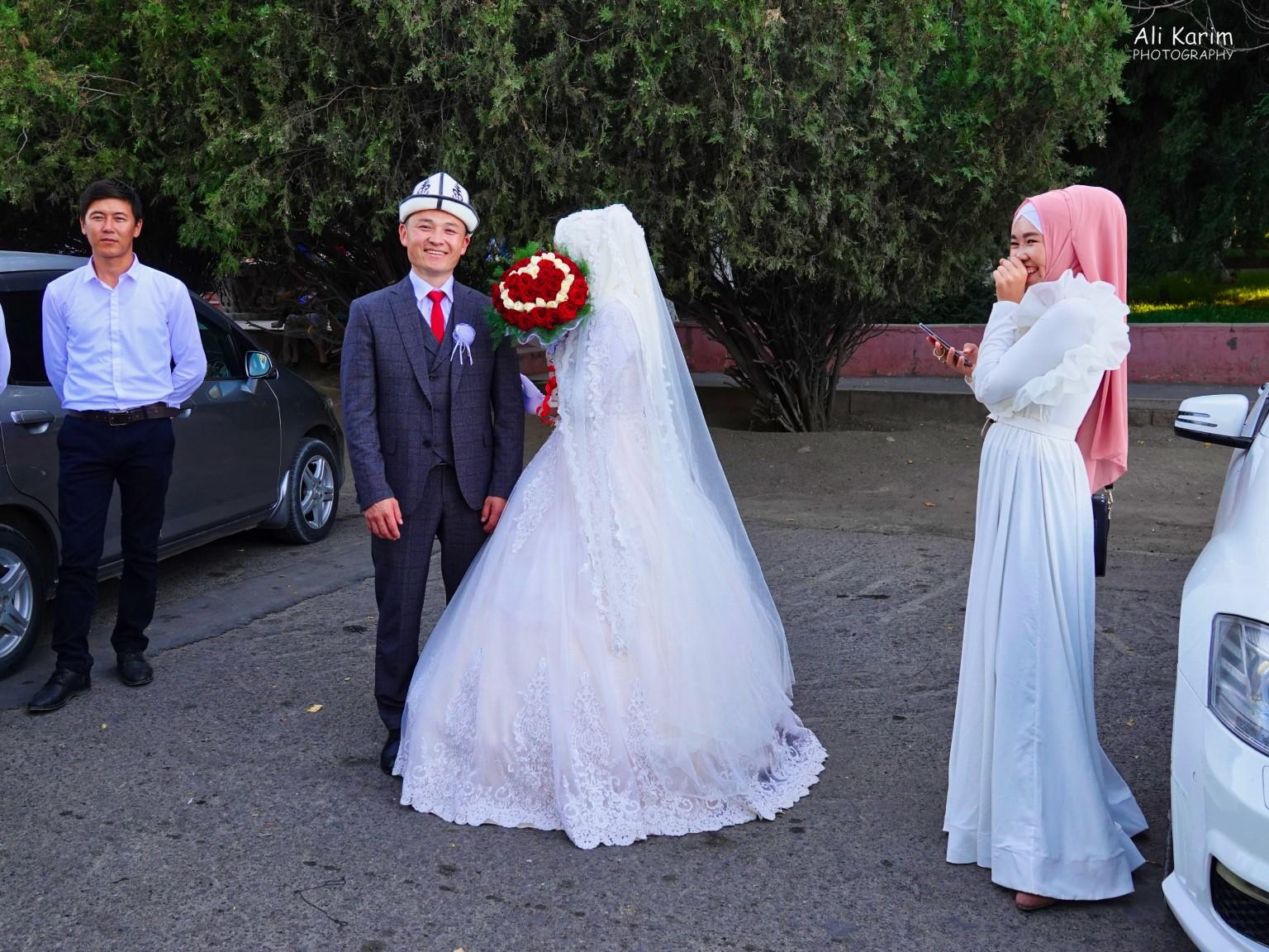 Silk Road 15: Osh, Kyrgyzstan Wedding 2; this bride was very shy; note bridesmaid having a good giggle at her
