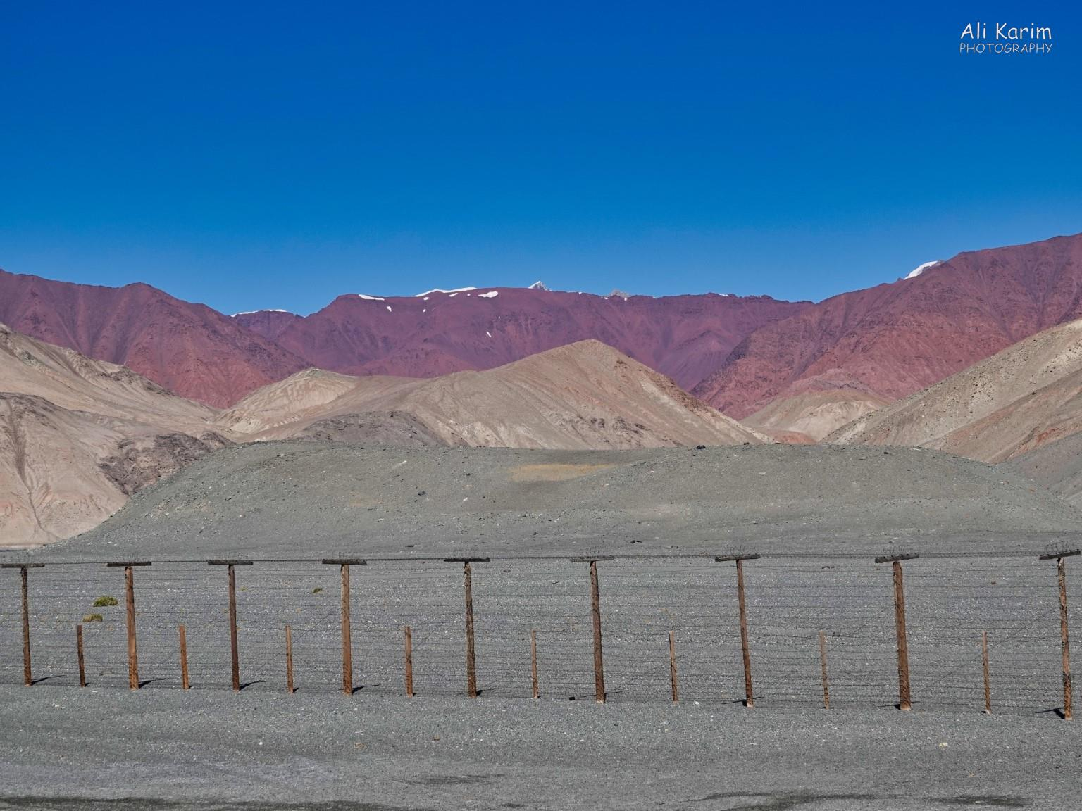 Silk Road 18: Murghab, Tajikistan Border fence erected by the Soviets, to create a buffer zone with China, which is on the other side of these Pamir mountains