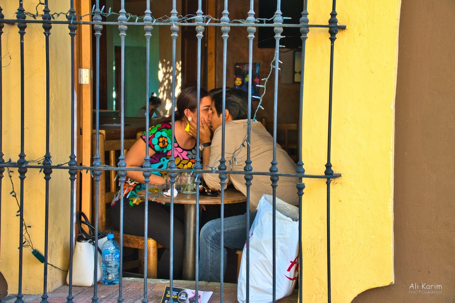 Oaxaca, Mexico Lovebirds; she saw me out of the corner of her eye & terminated the smooching :). The colorful top she is wearing is typical of Oaxaca