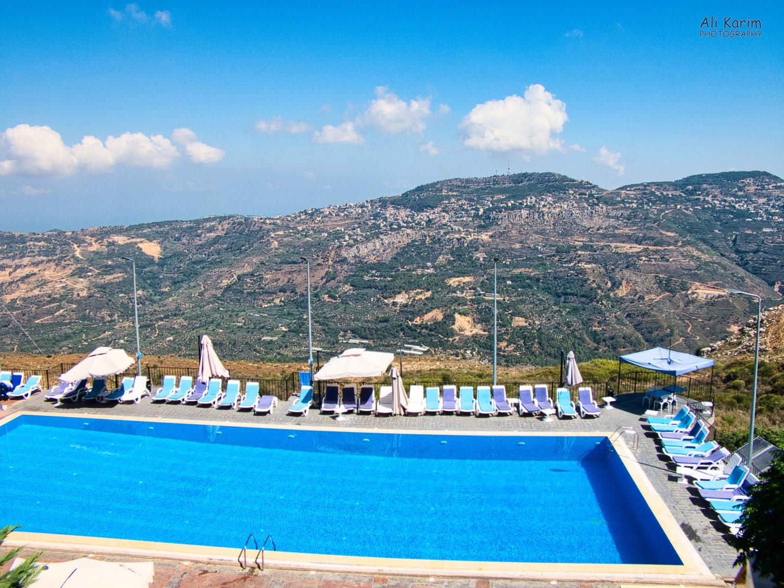 Druze and the Chouf Mountains Hotel and restaurant, with small towns across on the other side of the valley on the mountain-sides