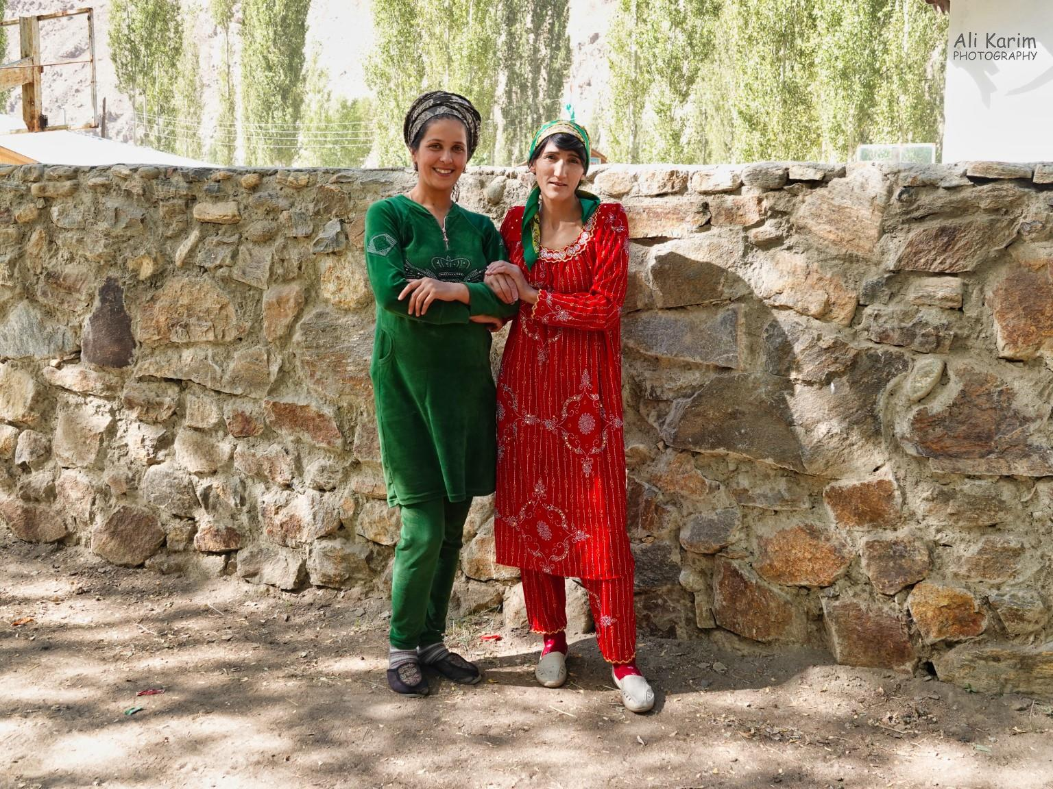 Onto Khorog, Tajikistan, Friendly pamiri ladies nicely dressed in red and green