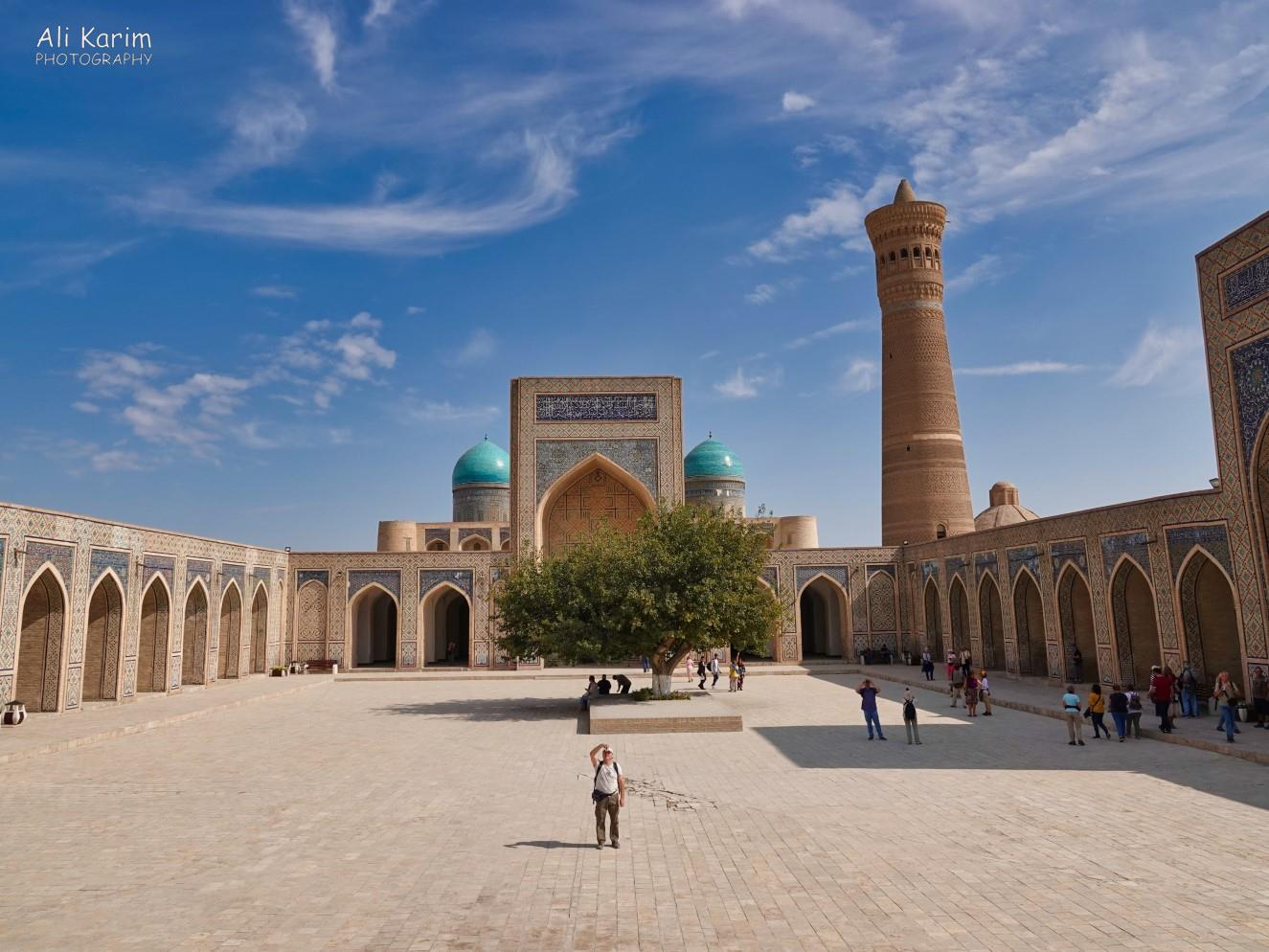 Bukhara, Oct 2019, Inside the huge and impressive Kalyan mosque, with the equally impressive Kalyan minaret. The blue domes in the back belonged to the Mir Arab madrassah opposite the mosque. The mosque was designed to hold 12,000 worshippers