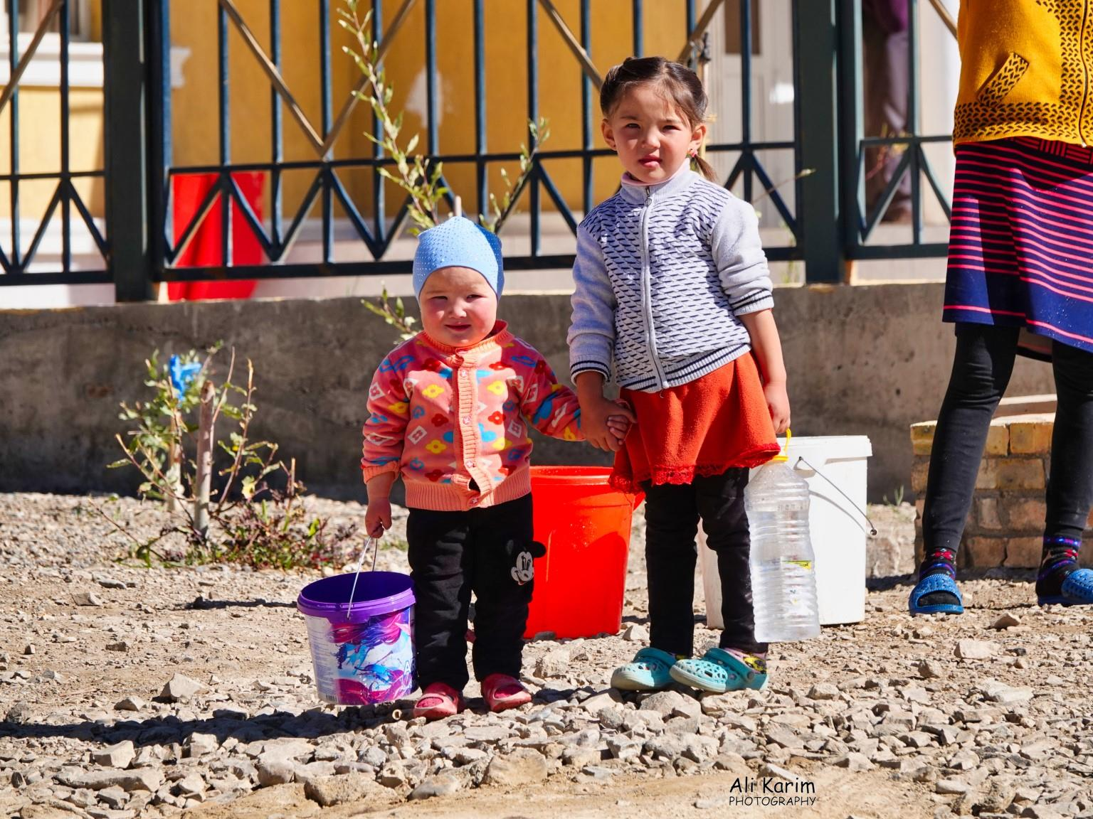 More Murghab & Alichur, Tajikistan, Little ones in the family pitch in to help collect water