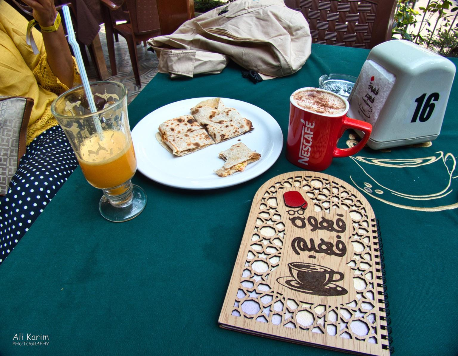 Tripoli Lebanon Breakfast in nice outdoor patio; note the menu which was in Arabic, and all backwards :)
