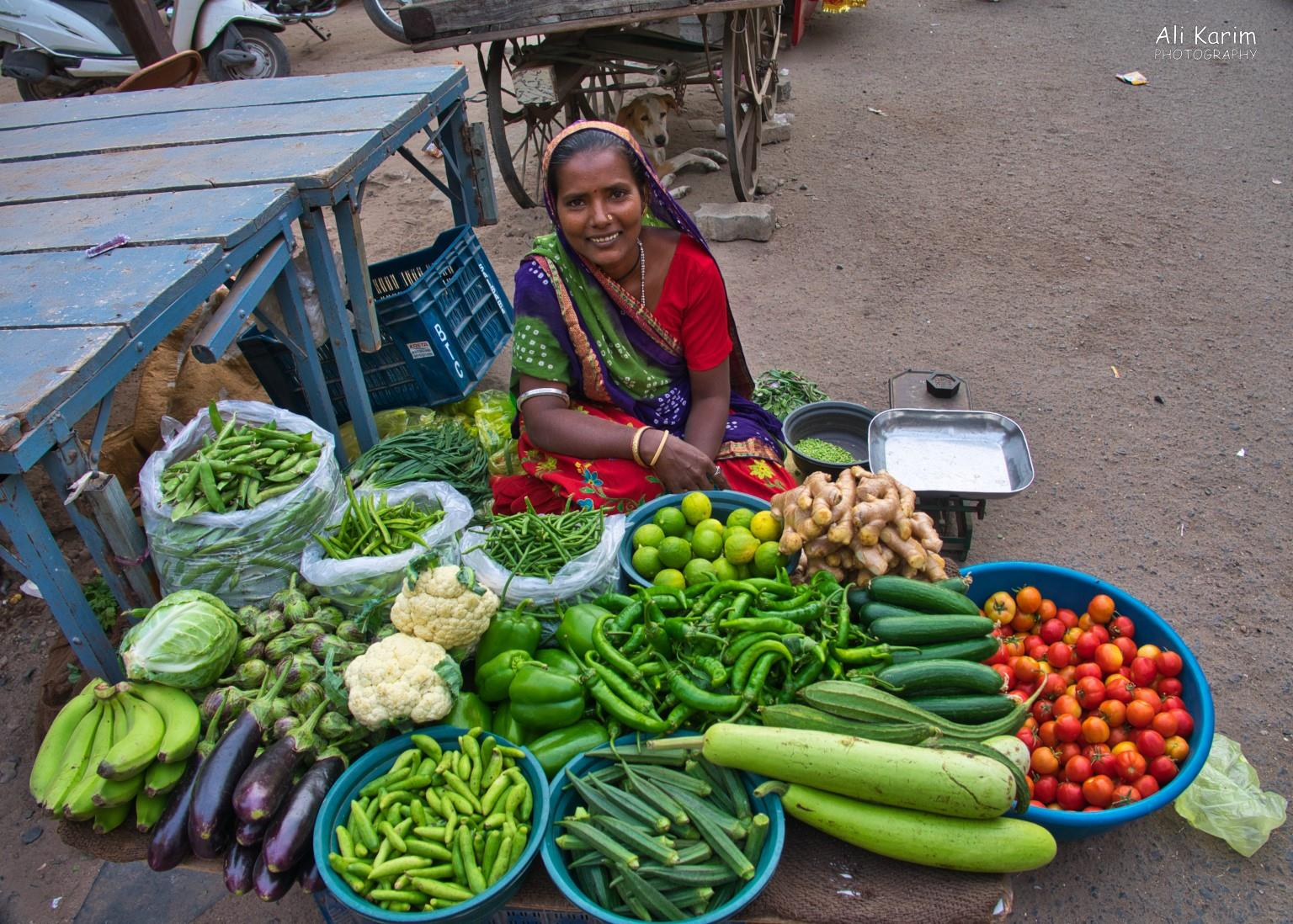 More Bhuj Happy vegetable seller outside the vegetable market in the heart of the old city